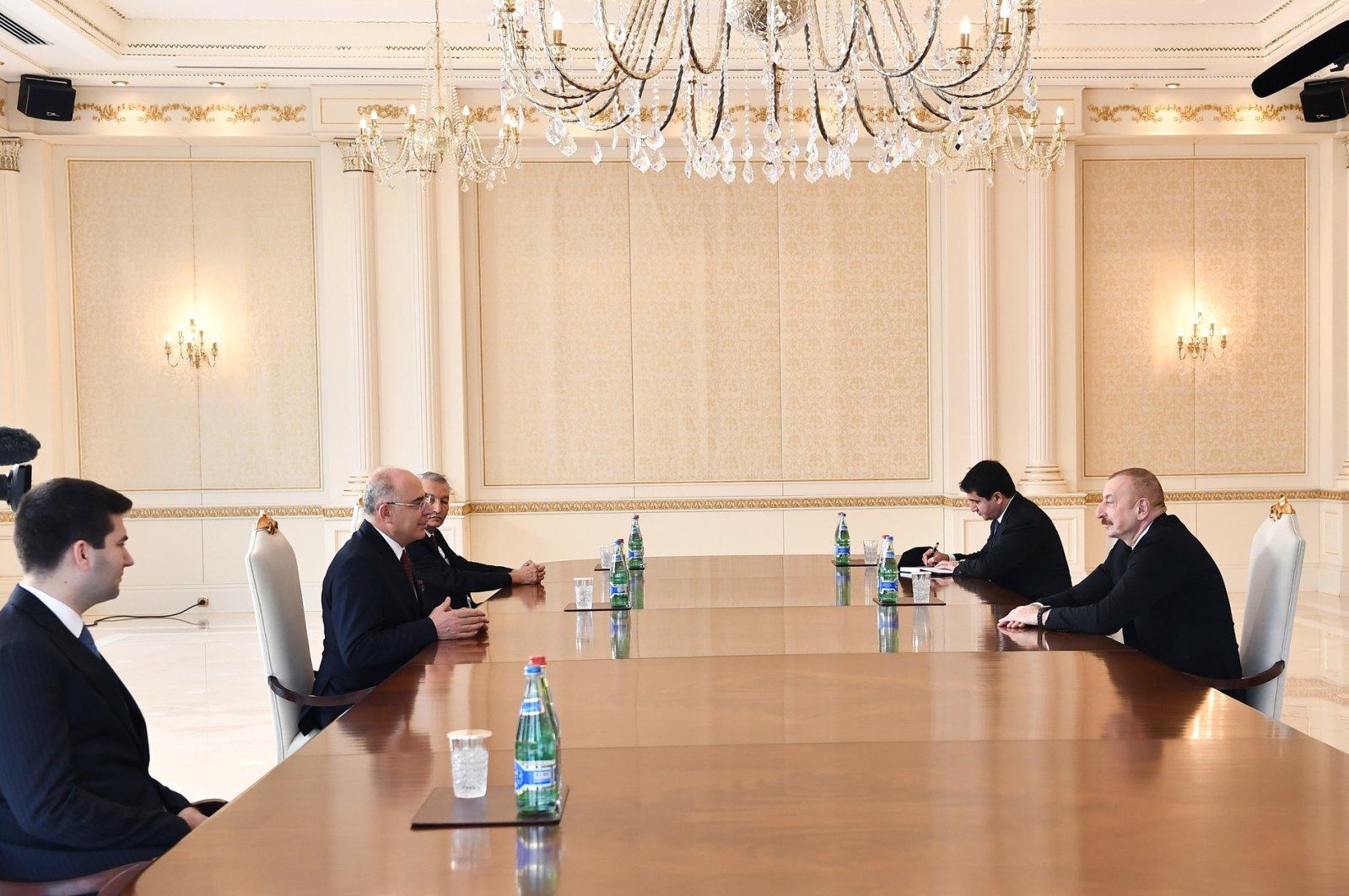 Azerbaijan's President Ilham Aliyev (R) receives a Nationalist Movement Party (MHP) delegation in the capital Baku, Azerbaijan, Feb. 2, 2021. (AA Photo)