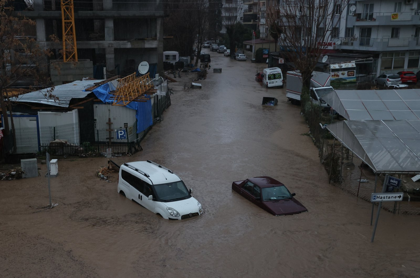 Vehicles submerged in floodwaters in the Karşıyaka district, in Izmir, western Turkey, Feb. 2, 2021. (AA PHOTO)