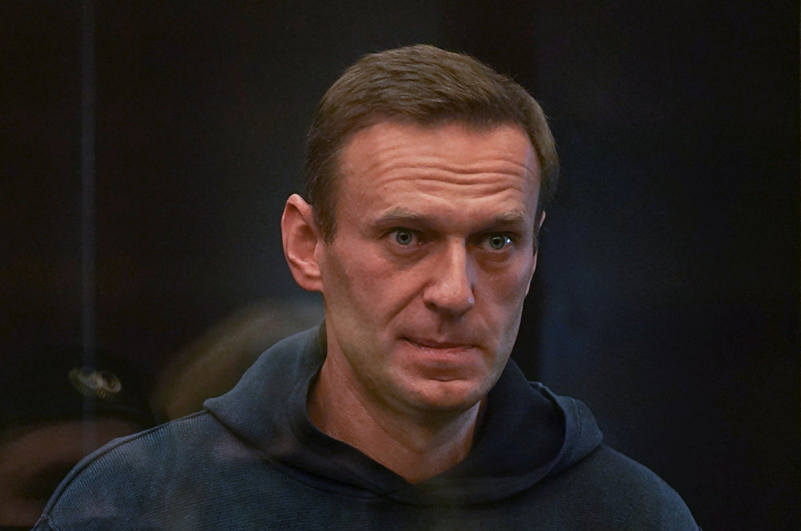 Russian opposition leader Alexei Navalny, accused of flouting the terms of a suspended sentence for embezzlement, attends a court hearing in Moscow, Russia Feb. 2, 2021. (Press service of Moscow City Court/Handout via Reuters)