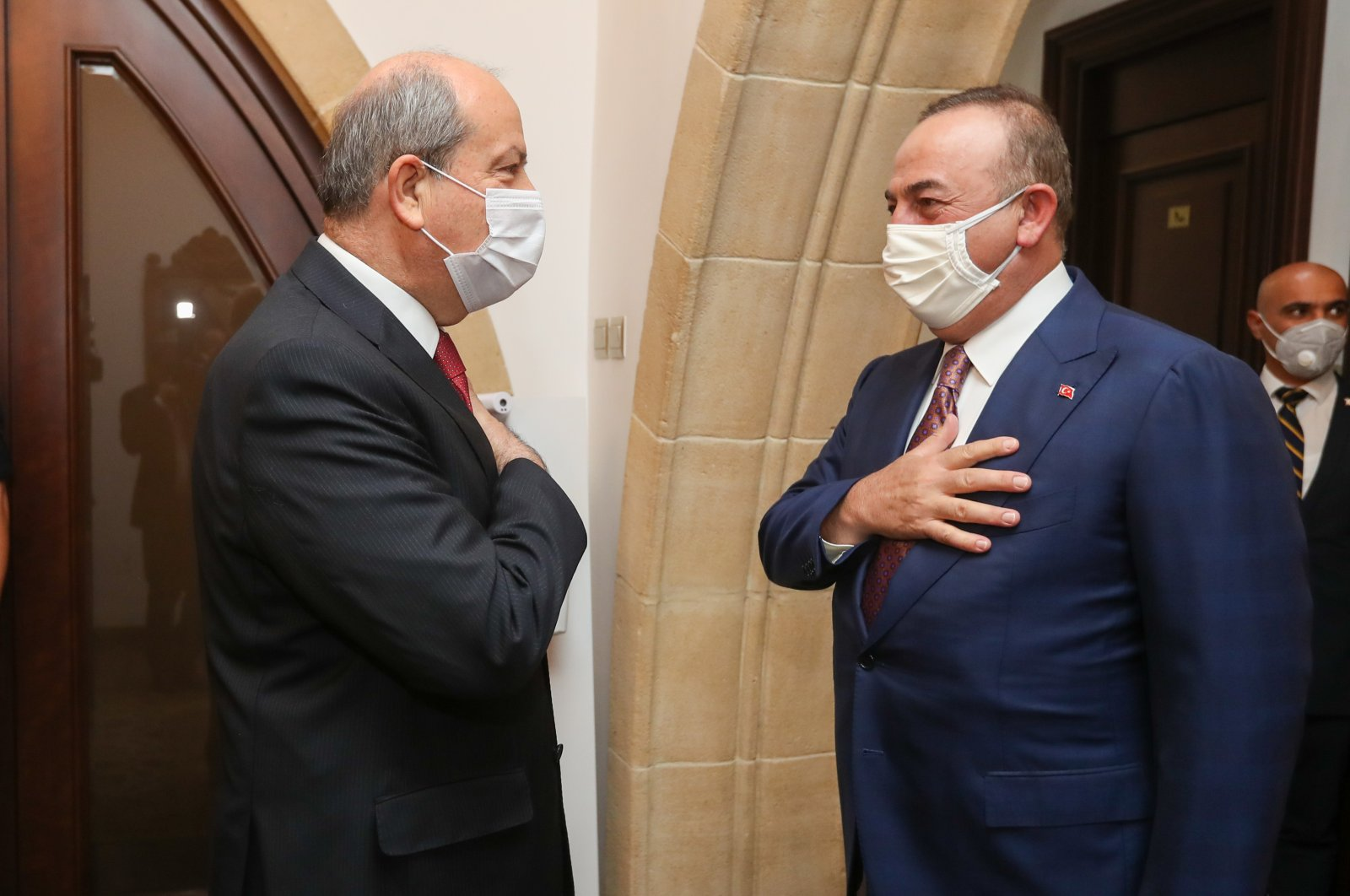 TRNC President Ersin Tatar receives Foreign Minister Mevlüt Çavuşoğlu in Nicosia, TRNC, Feb. 2, 2021. (AA Photo)