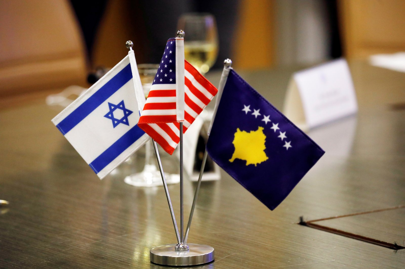 The flags of Israel, Kosovo and the U.S. are seen on a desk during a virtual ceremony to sign an agreement establishing diplomatic relations between Israel and Kosovo in the Israeli foreign ministry in Jerusalem February 1, 2021. (Reuters Photo)