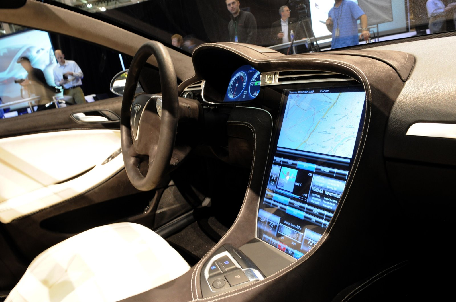 In this file photo the touch-screen control panel of the Tesla Model S all-electric sedan (L), is viewed at the car's unveiling in Hawthorne, California on March 26, 2009. (AFP Photo)