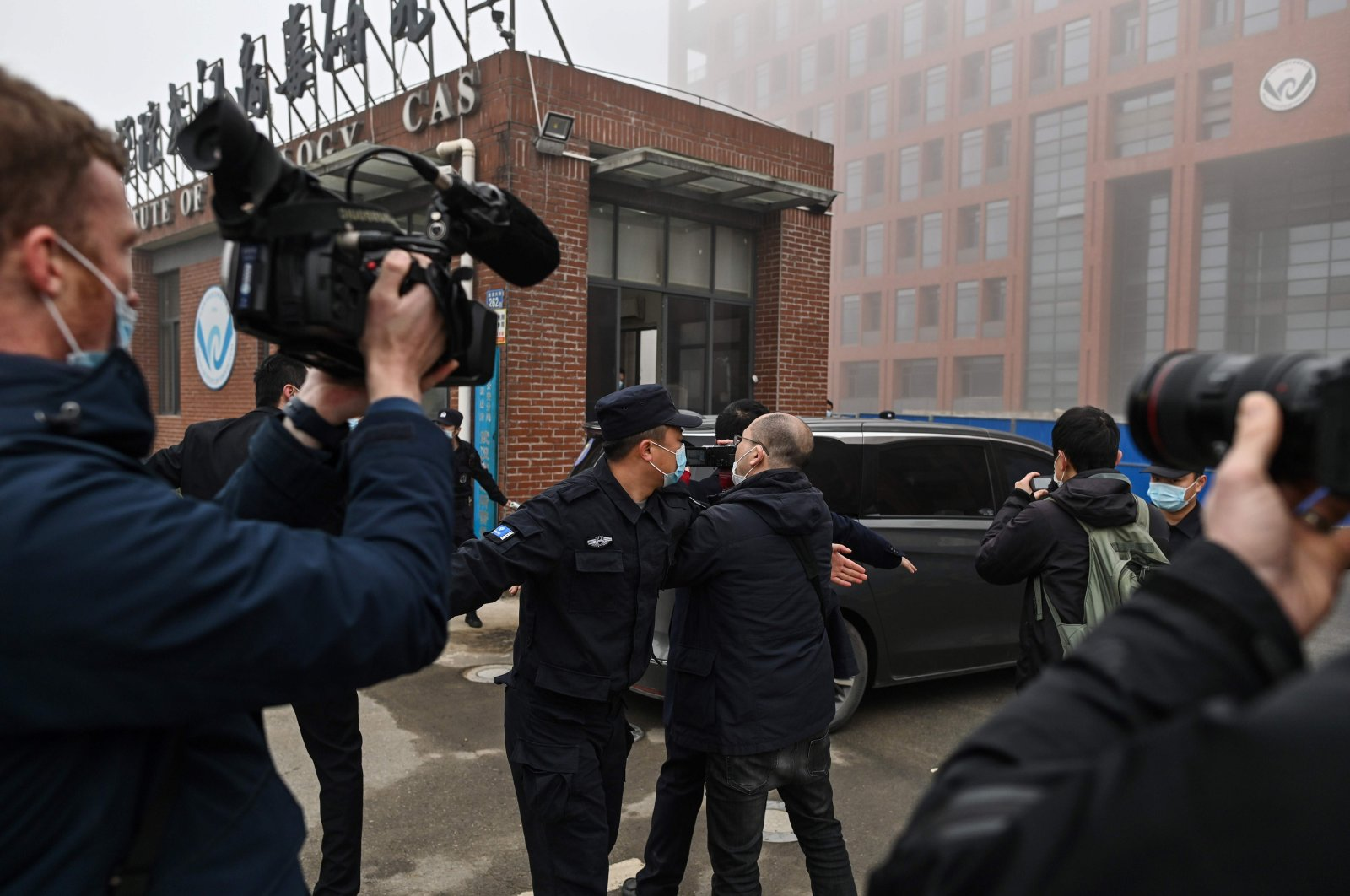 Members of the World Health Organization (WHO) team investigating the origins of the COVID-19 coronavirus, arrive at the Wuhan Institute of Virology in Wuhan, in China's central Hubei province on Feb. 3, 2021. (AFP Photo)