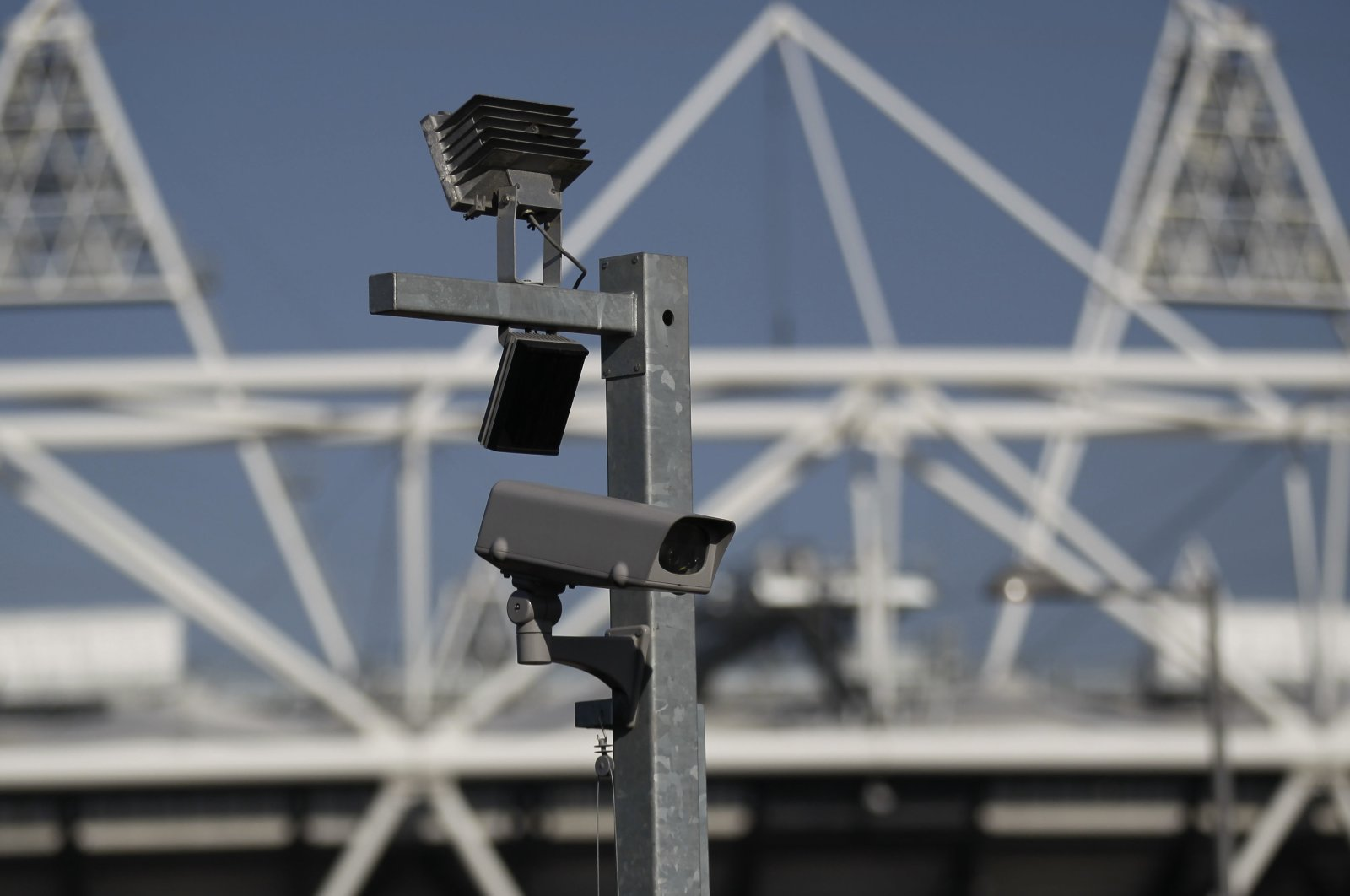 A closed-circuit security camera is seen by the Olympic Stadium at the Olympic Park in London, U.K., March 28, 2012. (AP Photo)