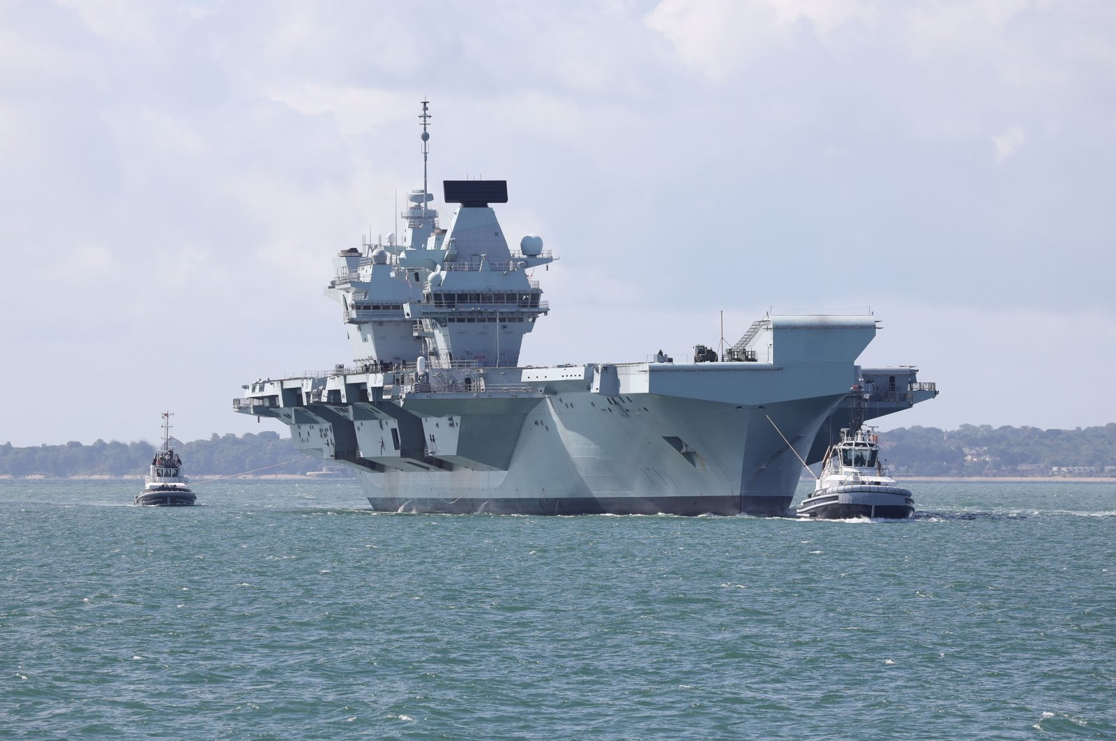 The aircraft carrier HMS Queen Elizabeth returns to its home port after the completion of Exercise Crimson Ocean, Portsmouth, Britain, July 2, 2020. (Shutterstock Photo)