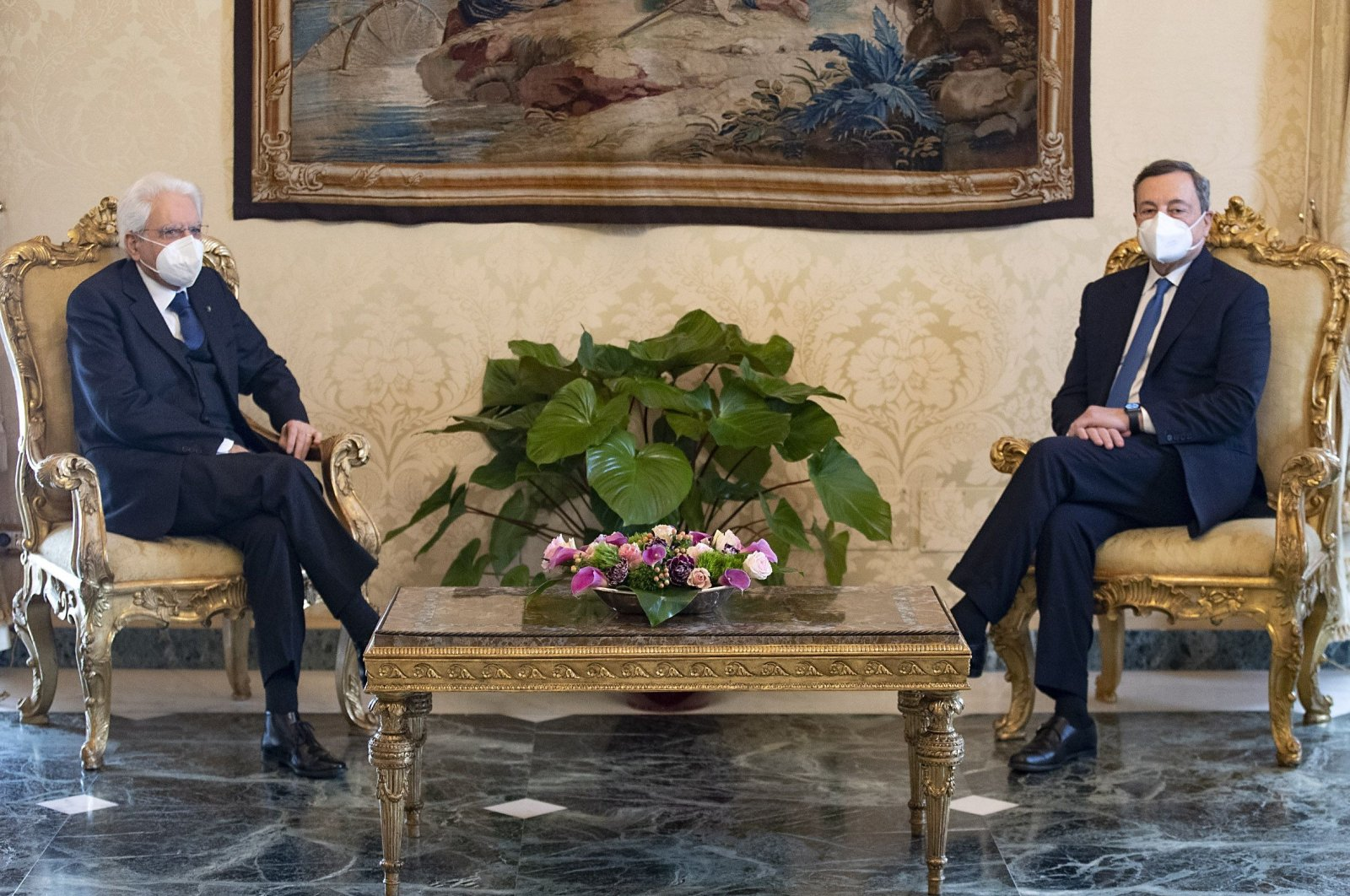 This handout picture taken and released by the Quirinal press office shows former Italian head of the European Central Bank Mario Draghi (R) and Italian President Sergio Mattarella in a meeting, at the Quirinal Palace, in Rome, Italy, Feb. 3, 2021. (AFP Photo)