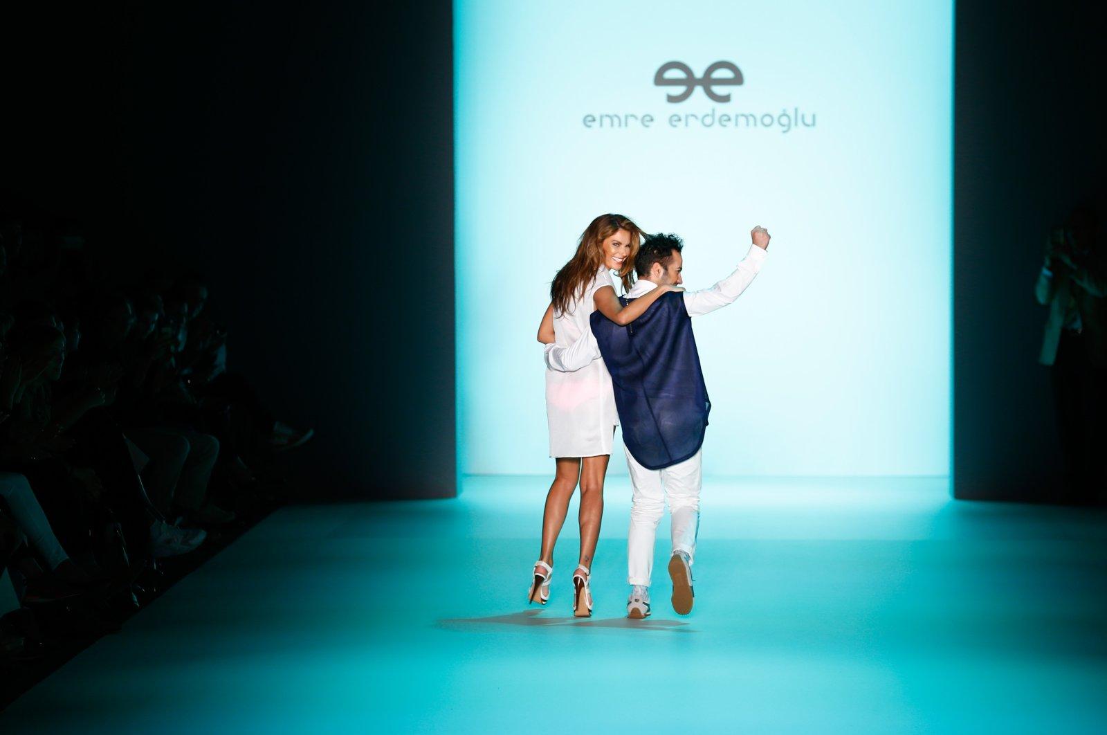 Designer Emre Erdemoğlu and model Tülin Şahin walk the runway after his show during the Mercedes-Benz Fashion Week Berlin Spring/Summer 2016 at Brandenburg Gate on July 10, 2015 (Getty Images for Mercedes-Benz)