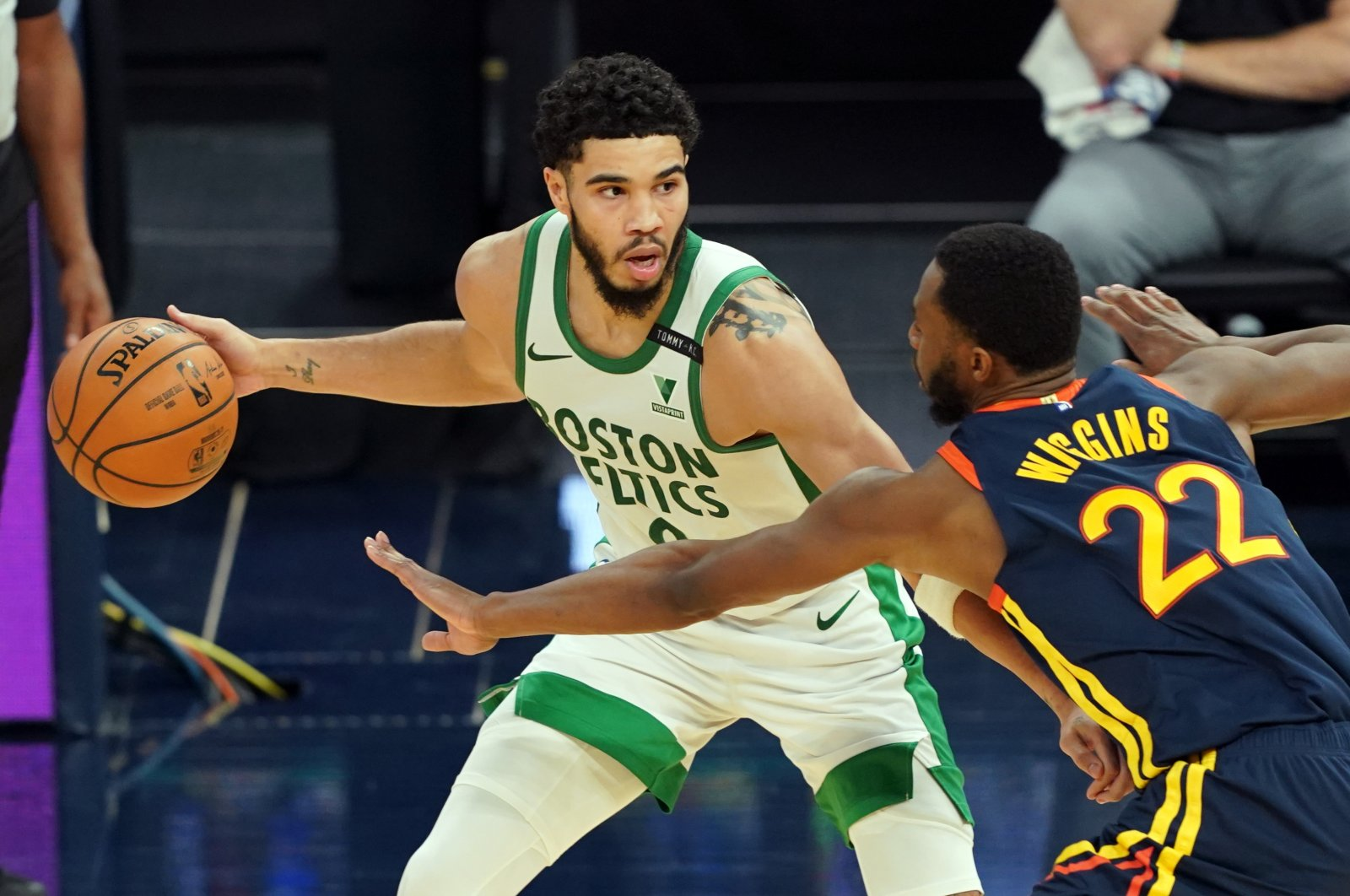 Boston Celtics forward Jayson Tatum (L) handles the ball while being defended by Golden State Warriors forward Andrew Wiggins (R) during the third quarter at Chase Center, San Francisco, California, U.S., Feb. 2, 2021. (Reuters Photo)