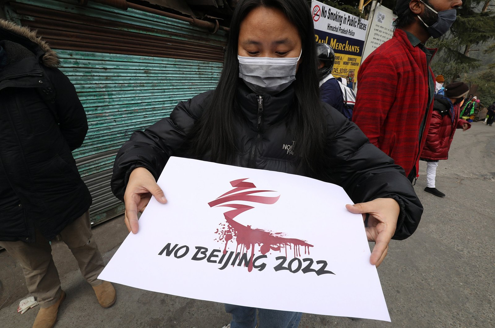 Tibetans living in exile and activists belonging to different NGOs hold placards during a protest against alleged Chinese atrocities and to boycott the 2022 Beijing Winter Olympics, at McLeod Ganj near Dharamsala, India, Feb. 3, 2021.