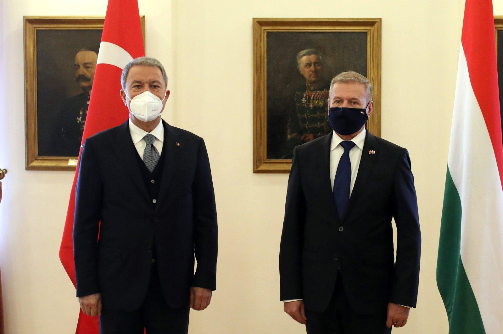 Defense Minister Hulusi Akar (L) and his Hungarian counterpart Tibor Menko meet in the capital Budapest, Hungary, Feb. 3, 2021. (AA Photo)