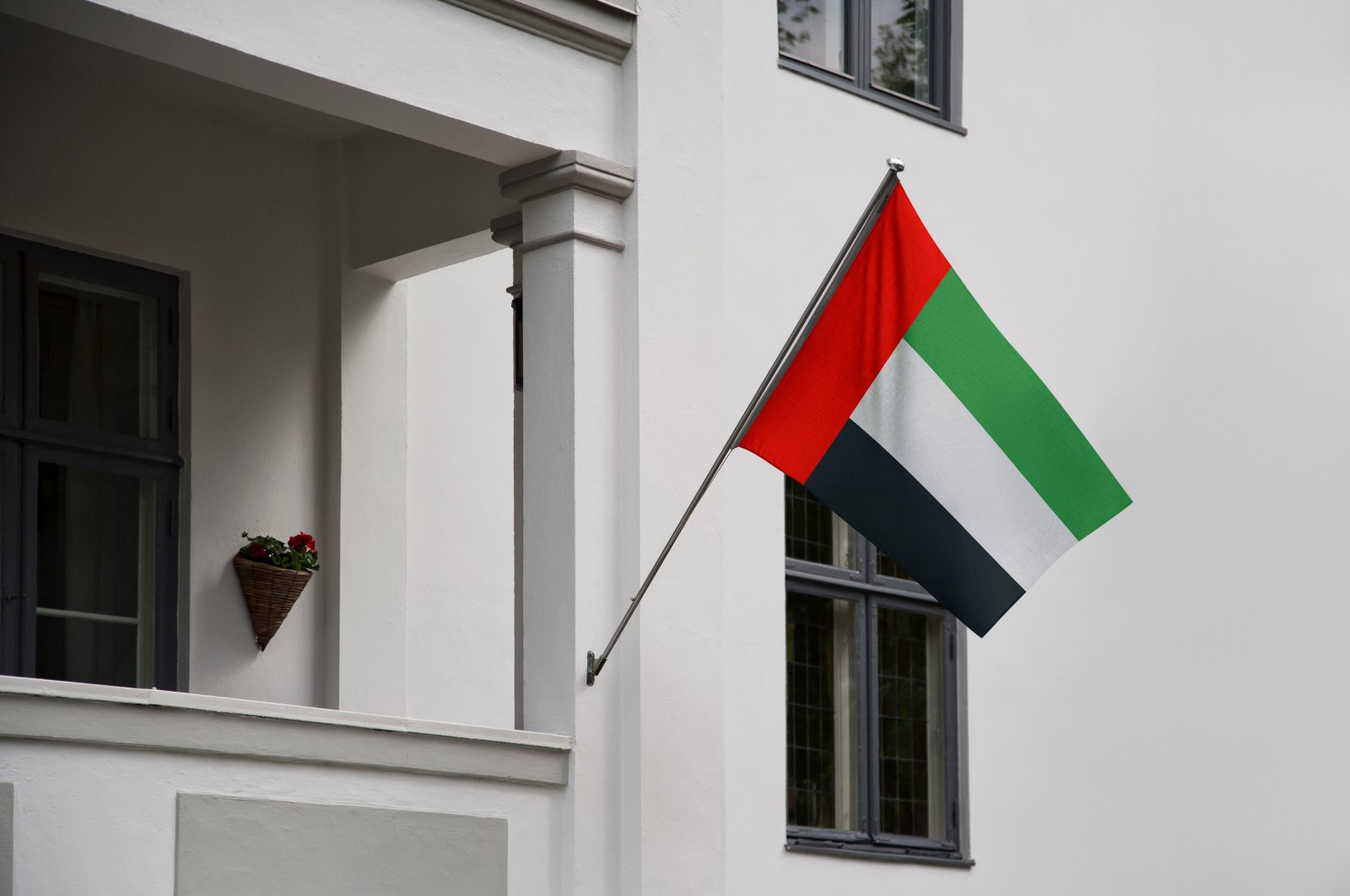 An undated photo shows the flag of the United Arab Emirates (UAE) hanging from a pole on a front door of a building. (Shutterstock)