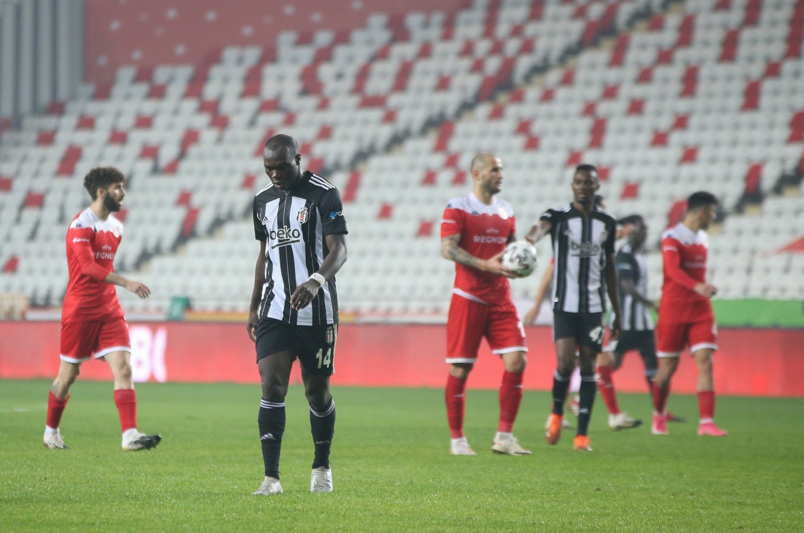 Beşiktaş's Vincent Aboubakar (2-L) walks out of the pitch at the end of the Turkish Süper Lig match in Antalya, Feb. 3, 2021 (AA Photo)