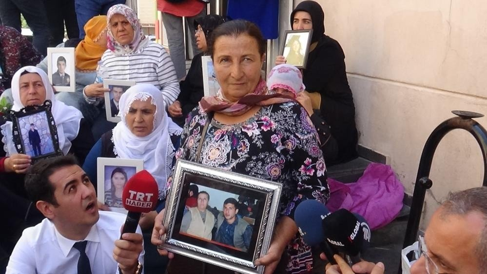 Selma Han holds a photo of herself and her son Onor Han, who was kidnapped by PKK terrorists, during a protest in front of the Peoples' Democratic Party's (HDP) headquarters in Turkey's southeastern Diyarbakır province, Feb. 4, 2021. (DHA Photo)