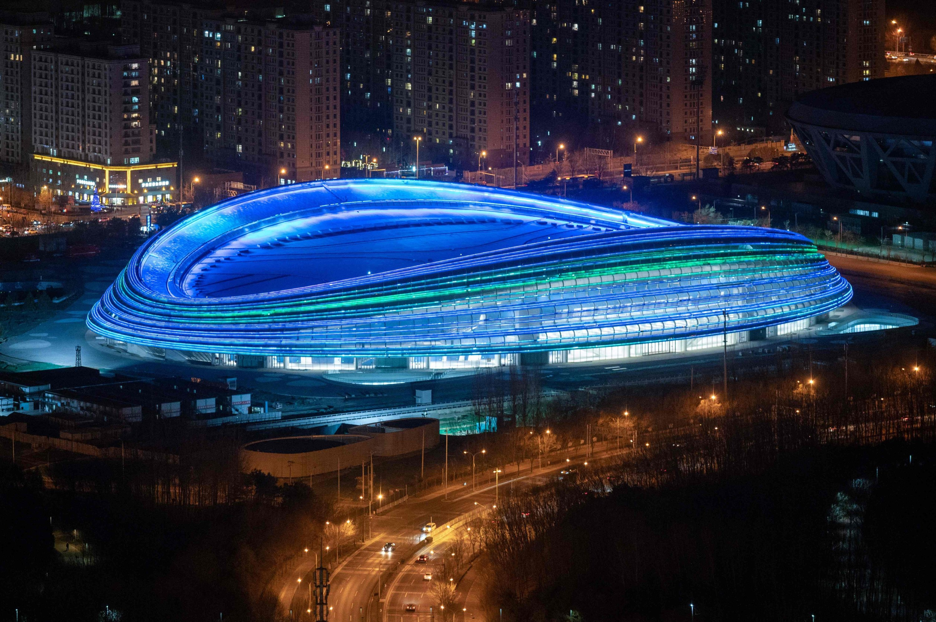 The National Speed Skating Oval, also known as the 'Ice Ribbon,' the speed skating venue for the 2022 Winter Olympics, Beijing, Feb. 3, 2021. (AFP Photo)