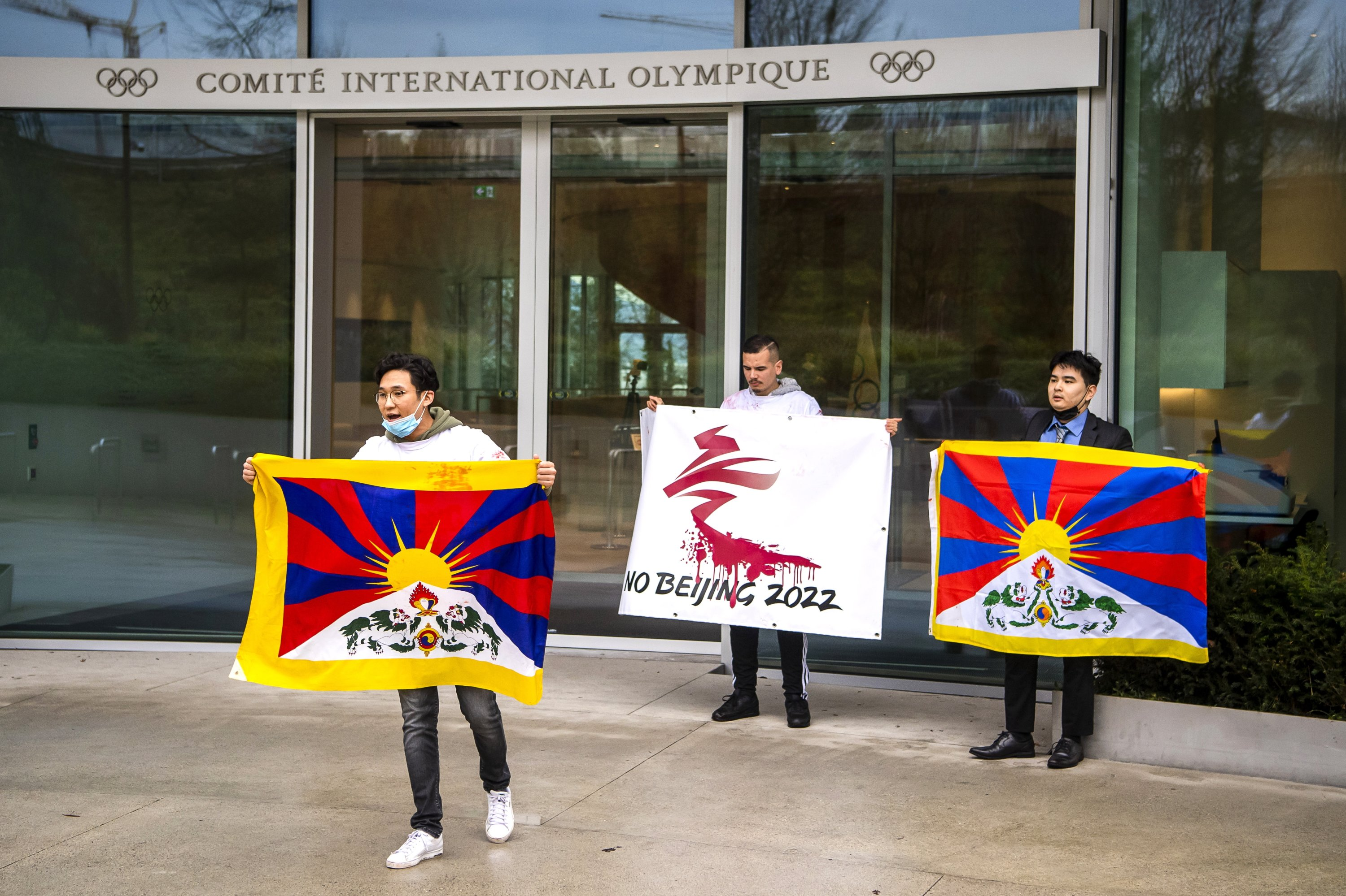 Protesters hold Tibetan flags during a protest against the Beijing 2022 Winter Olympic Games by activists of the Tibetan Youth Association in Europe in front of the International Olympic Committee (IOC) headquarters in Lausanne, Switzerland, Feb. 3, 2021. (EPA Photo)