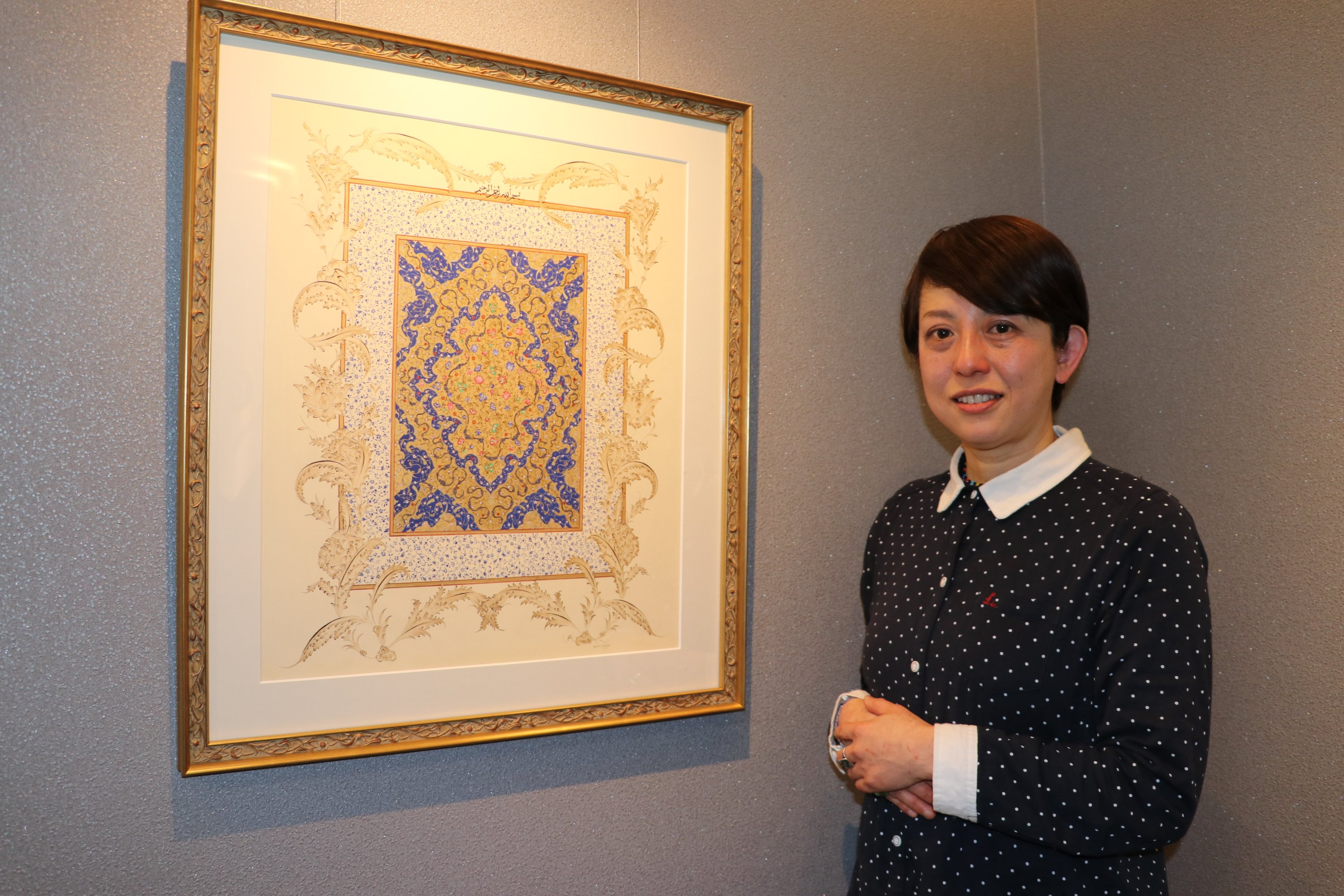 Fumiko Takahor poses with her work featuring saz yolu motif at Yunus Emre Institute, Tokyo, Japan, Feb. 3, 2020. (AA Photo)