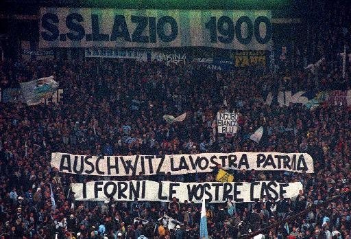 Lazio fans display banners from the stands reading