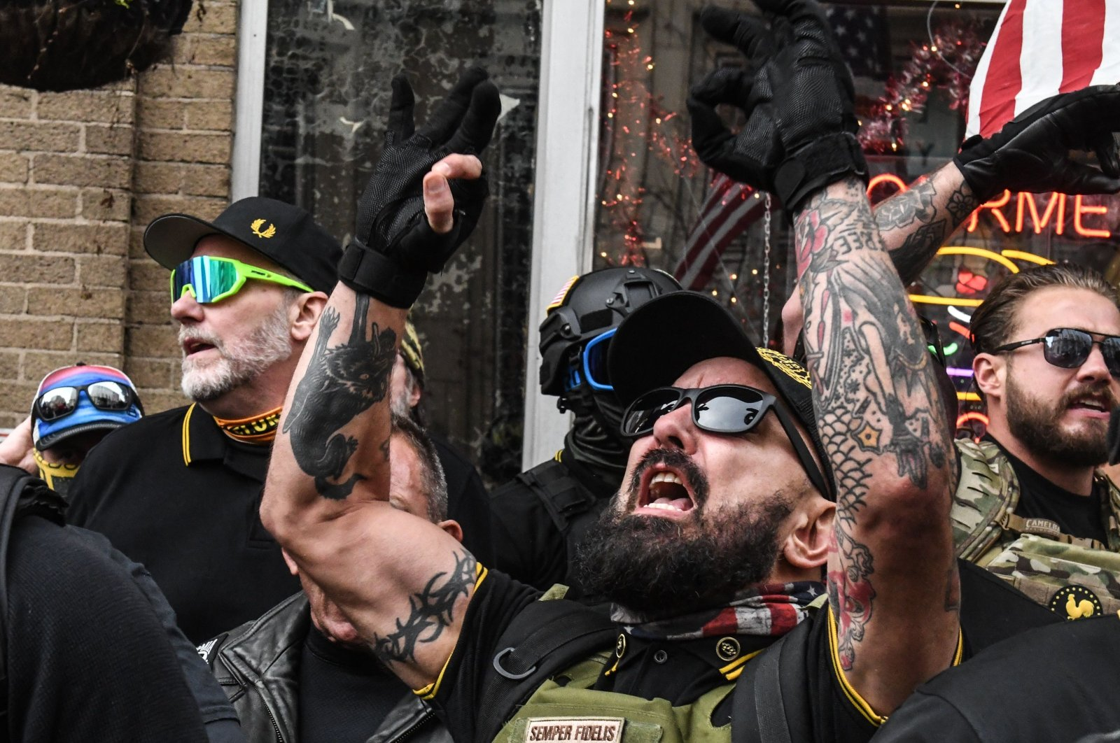 Members of the Proud Boys gather outside of Harry's bar during a protest in Washington, D.C. on Dec. 12, 2020. (AFP Photo)