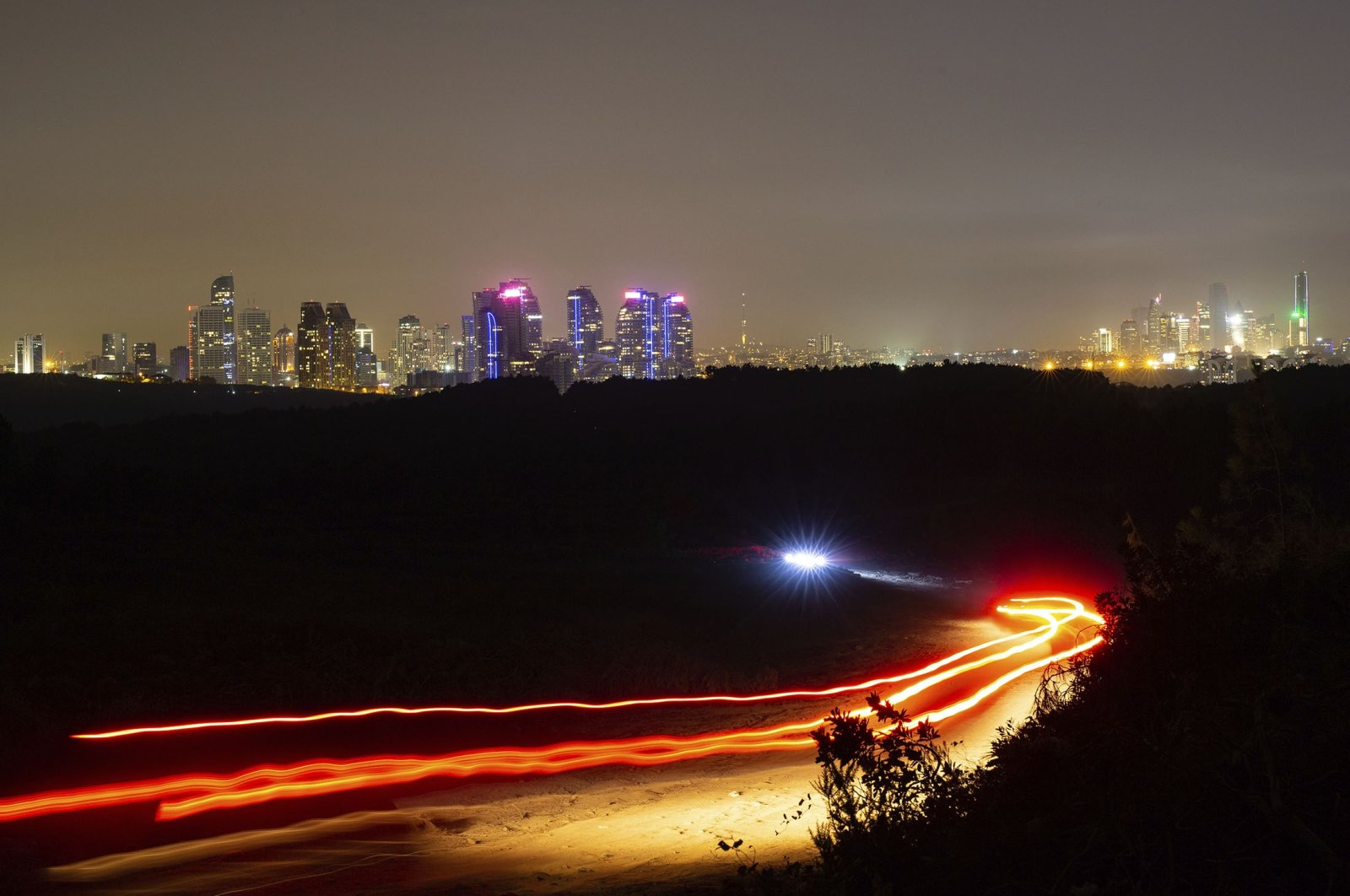 The lights of traffic are seen in the outskirts of Istanbul, Turkey, Oct. 6, 2020. (AP Photo)