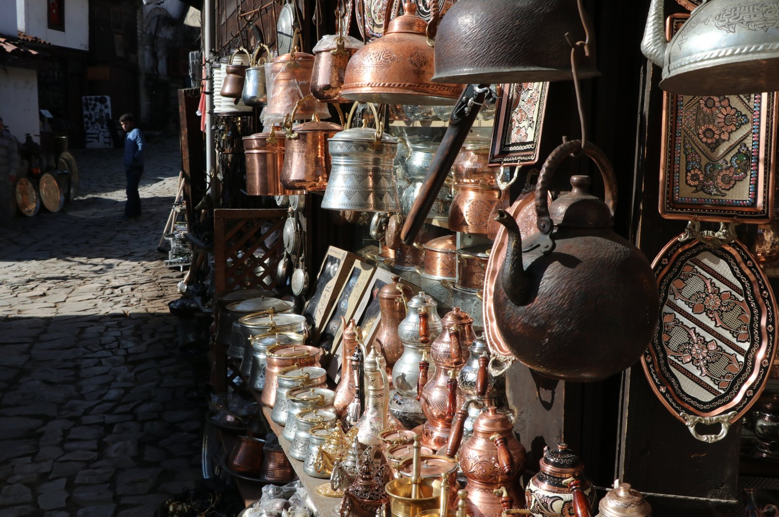 Various metal teapots and pitchers are on display at one of the workshops of the Blacksmiths Market in the Safranbolu district of Karabük, northern Turkey, Feb. 3, 2021. (IHA Photo)