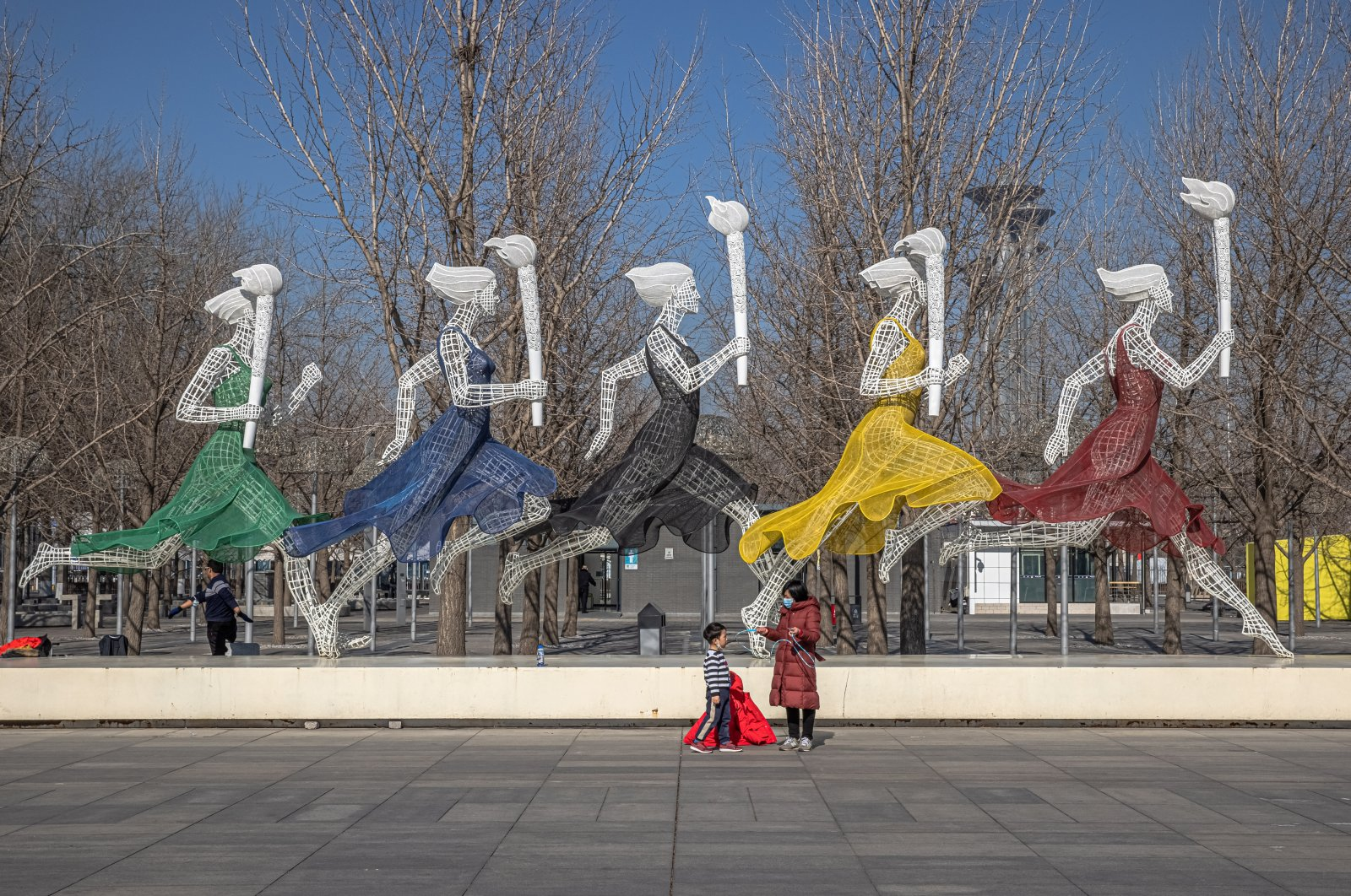 A woman with a young boy visit the Beijing Olympic Park 365 days before the 2022 Beijing Winter Olympics, in Beijing, China, Feb. 04, 2021. (EPA Photo)