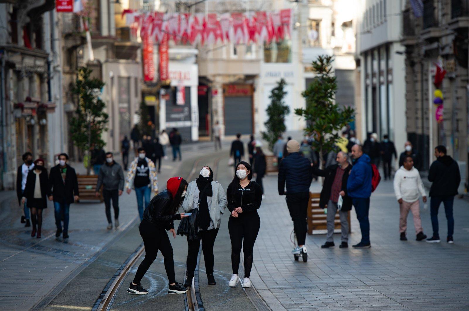 People walk on Istiklal Avenue, in Istanbul, Turkey, Jan. 31, 2021. (AFP Photo)