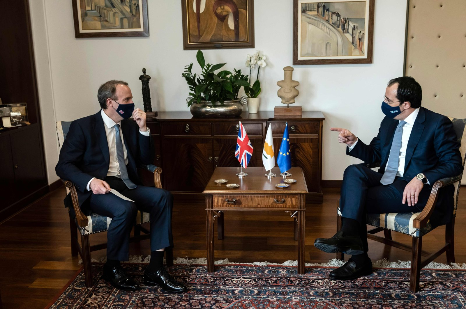Greek Cypriot Minister of Foreign Affairs Nikos Christodoulides (R) meets with his British counterpart Dominic Raab, in the capital Nicosia, Greek Cypriot administration, Feb. 4, 2021. (AFP Photo)