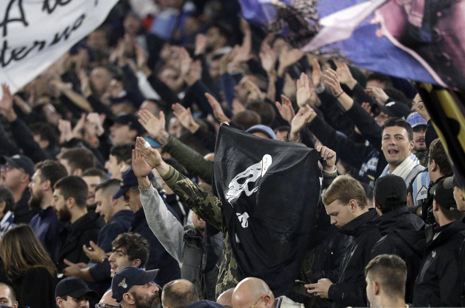 Lazio fans make fascist salutes ahead of a Europa League group E soccer match between Lazio and Celtic, at Olympic Stadium, Rome, Italy, Nov. 7, 2019. (AP Photo)