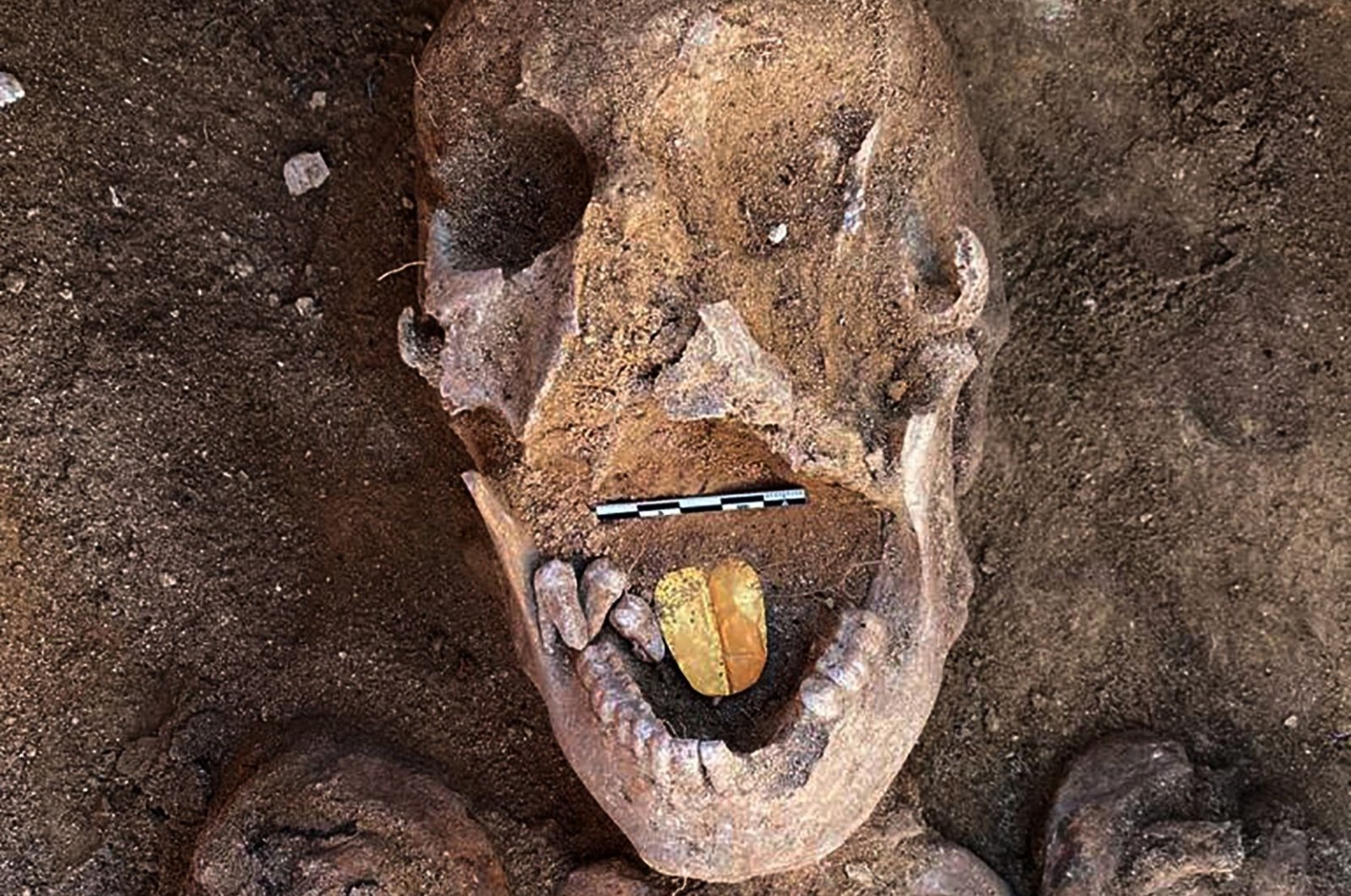 A 2,000-year-old mummy with a gold foil amulet inside his mouth is seen at the Taposiris Magna Temple in western Alexandria, Egypt, Jan. 29, 2021. (Egyptian Ministry of Antiquities via AFP)
