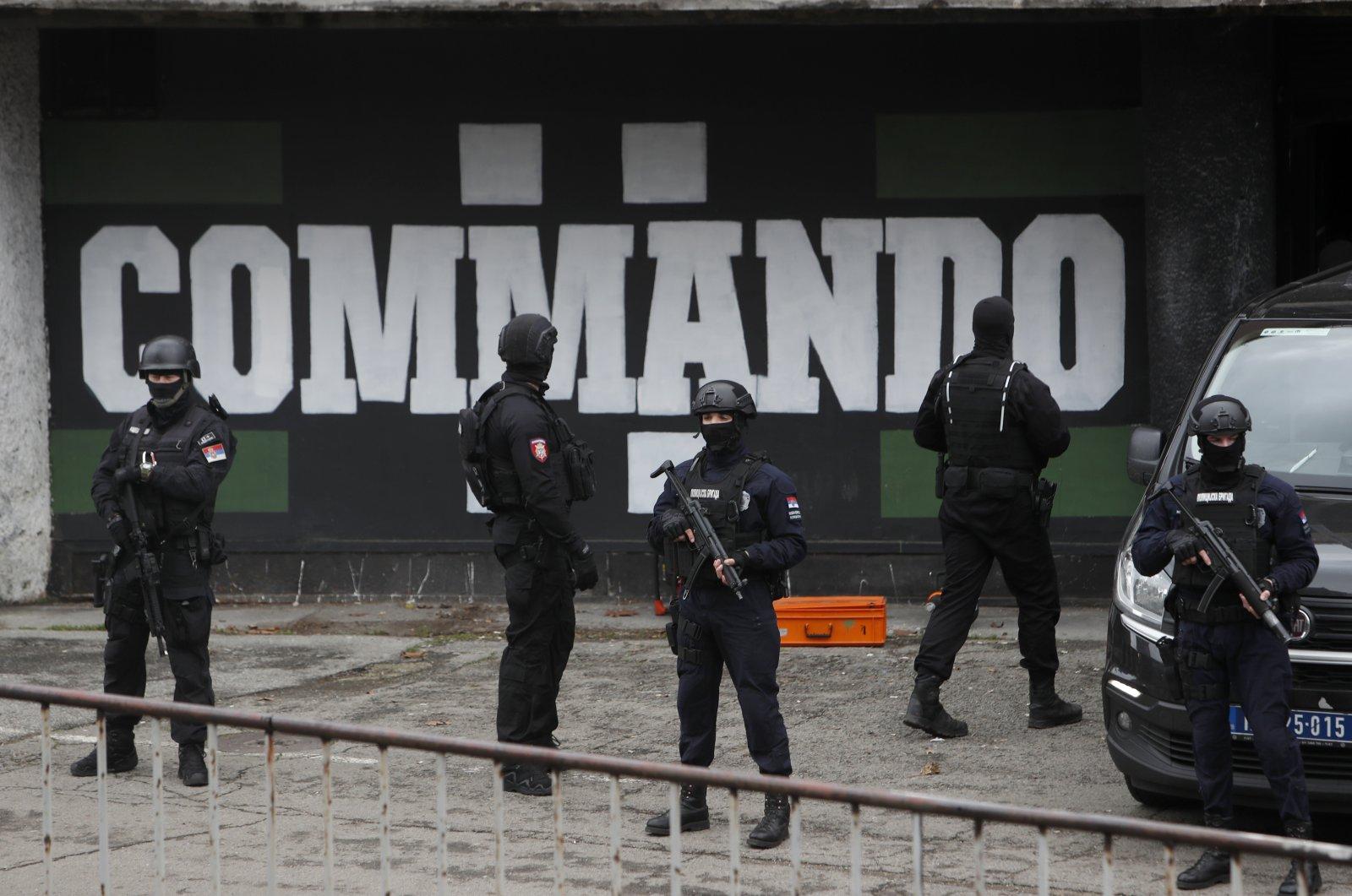 Serbian police officers guard Partizan stadium during a raid, in Belgrade, Serbia, Feb. 4, 2021. (AP Photo)