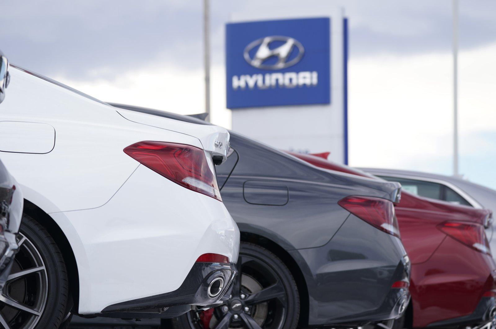 A long row of unsold 2021 Genesis sedans sit at a Hyundai dealership in Centennial, Colorado, U.S., Dec. 20, 2020. (AP Photo)