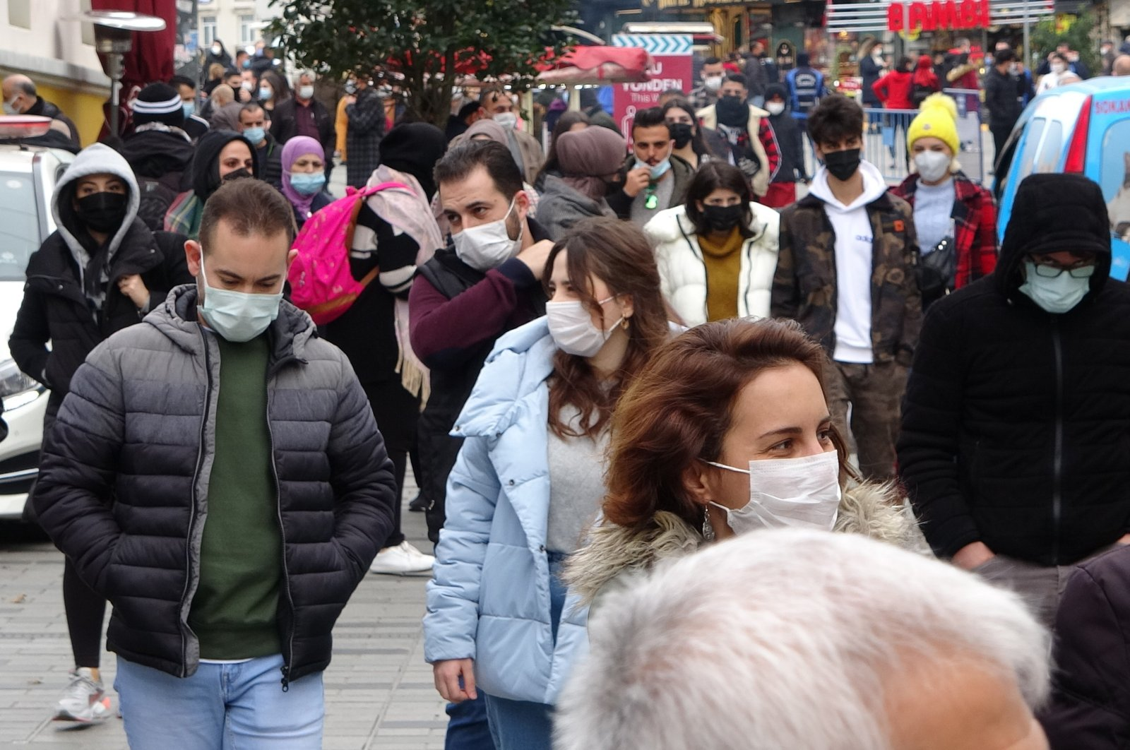 People with face masks walk on Istiklal Street near Taksim Square, in Istanbul, Turkey, Feb. 1, 2021. (IHA Photo)