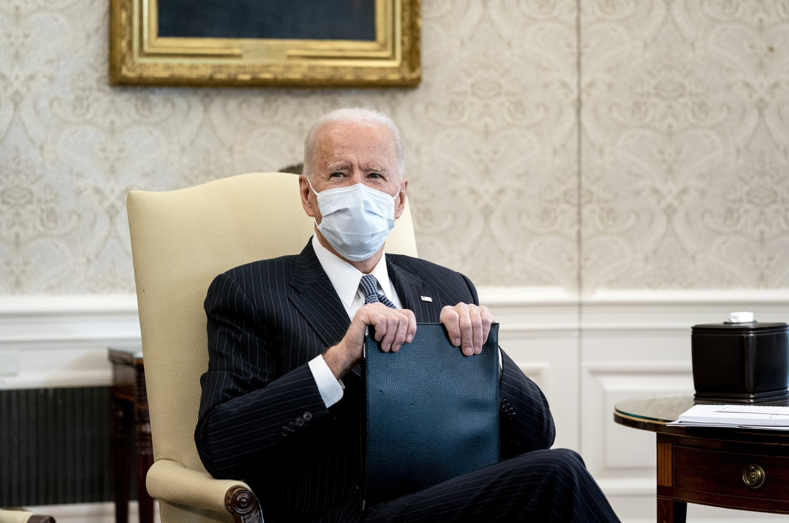 U.S. President Joe Biden wears a protective mask during a meeting with Democratic Senators to discuss the American Rescue Plan in the Oval Office of the White House in Washington, D.C., U.S., Feb. 3, 2021. (EPA Photo)