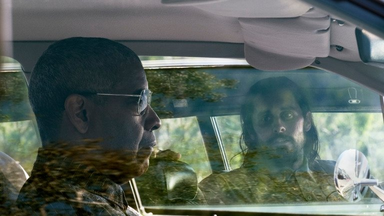 A still shot shows Denzel Washington (L) and Jared Leto in a scene from