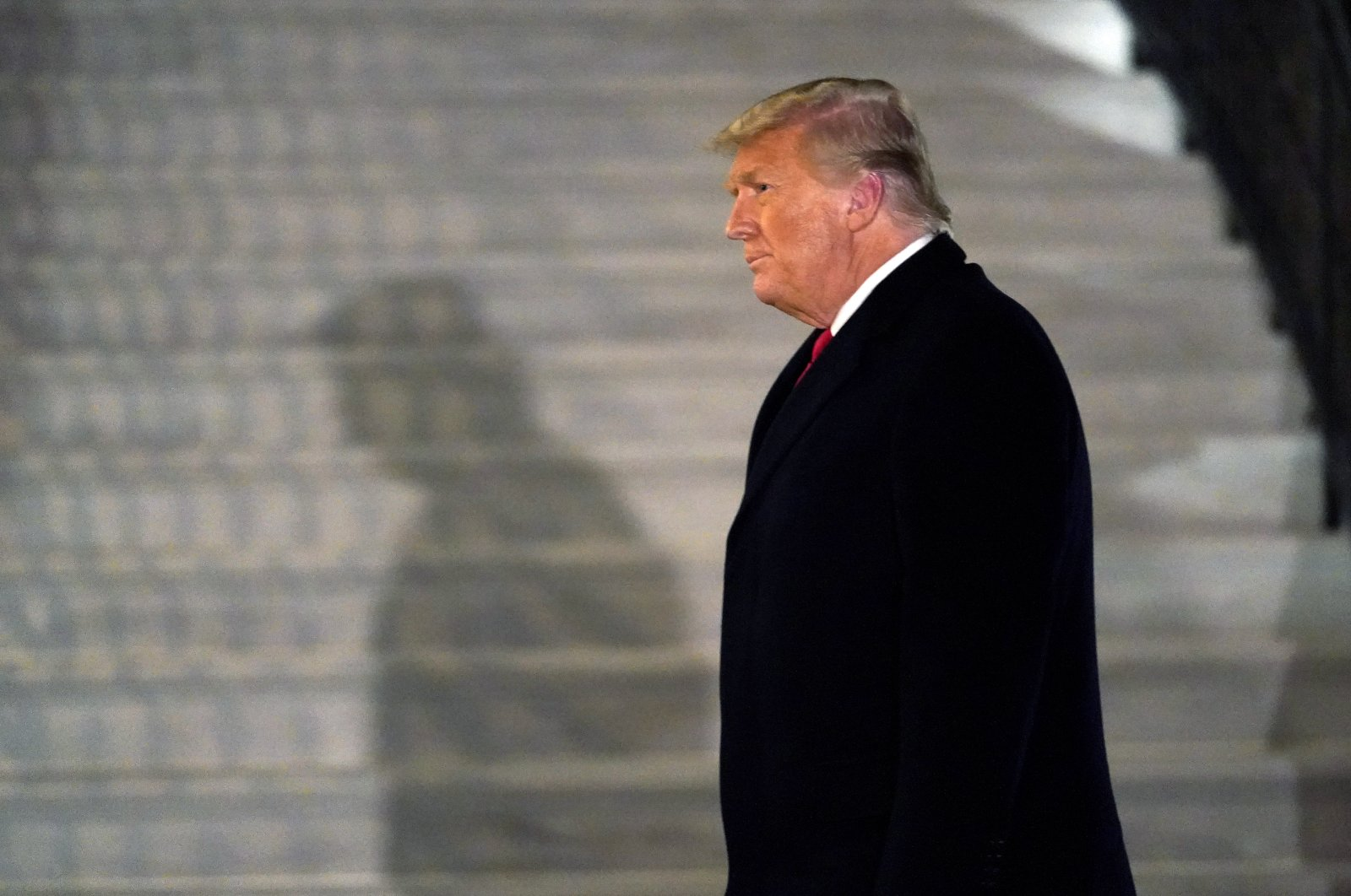 U.S. President Donald Trump arrives on the South Lawn of the White House, in Washington, after returning from Texas, Jan. 12, 2021. (AP Photo)