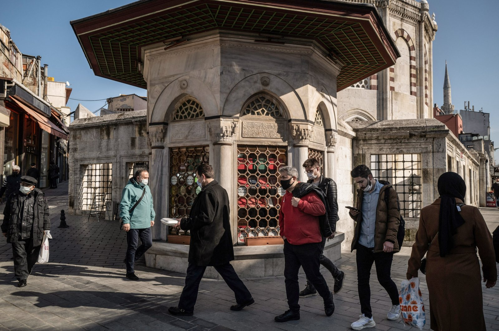 Pedestrians pass a bookstore housed in an annex to the Sinan Pasha Madrassa, Istanbul, Turkey, Feb. 2, 2021. (Photo by Getty Images)