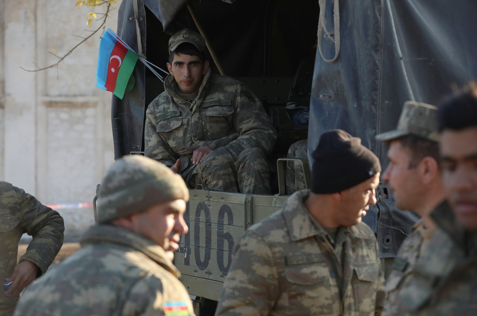 Azerbaijani service members gather in Agdam town in the region of Nagorno-Karabakh, Nov. 24, 2020. (REUTERS)