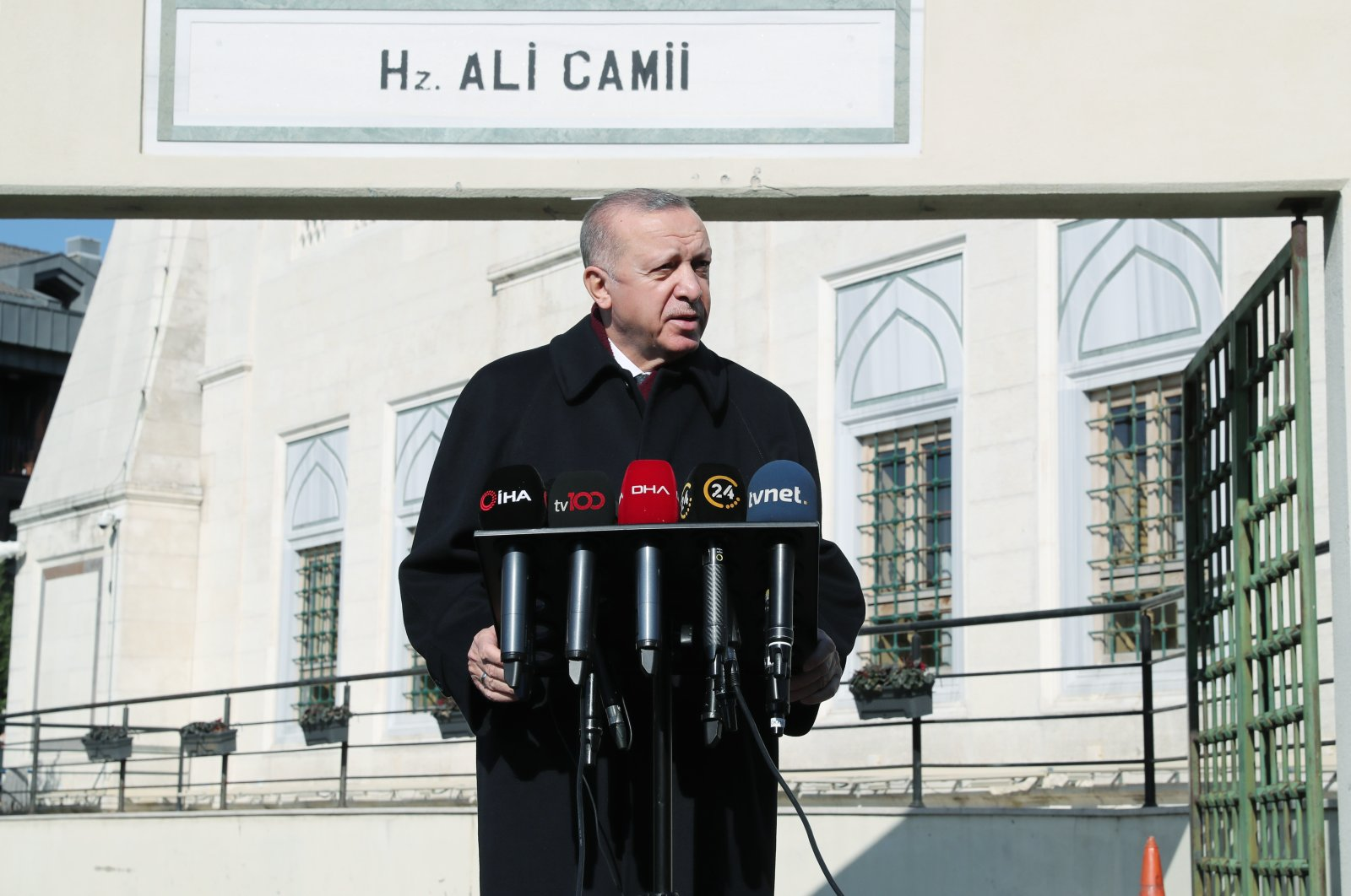 President Recep Tayyip Erdoğan speaks to reporters after Friday prayers in Istanbul, Turkey, Feb. 5, 2021. (AA Photo)