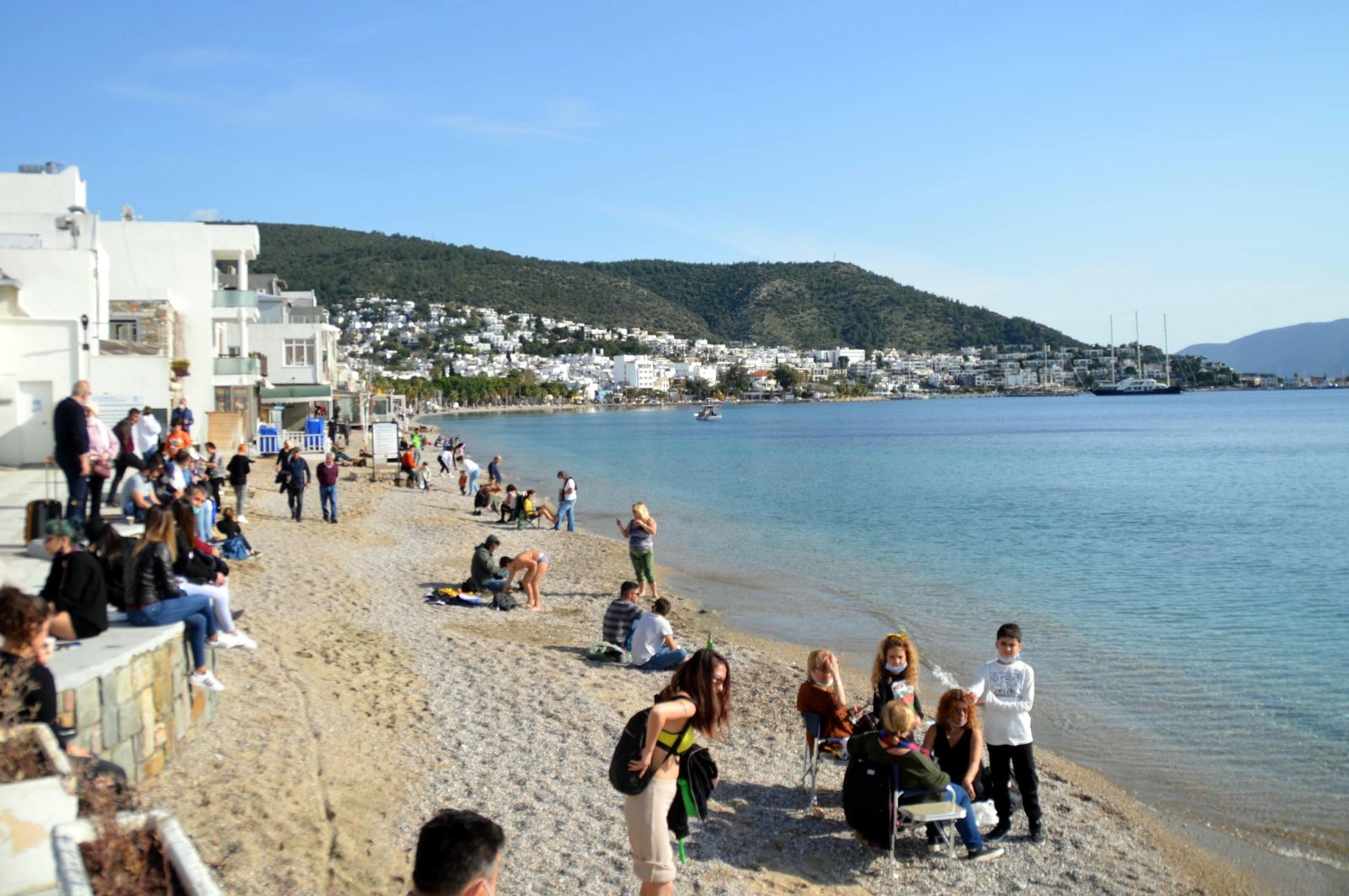 People are seen on a beach in thesouthwestern resort town of Bodrum, Muğla province, Turkey, Feb. 4, 2021. (DHA Photo)