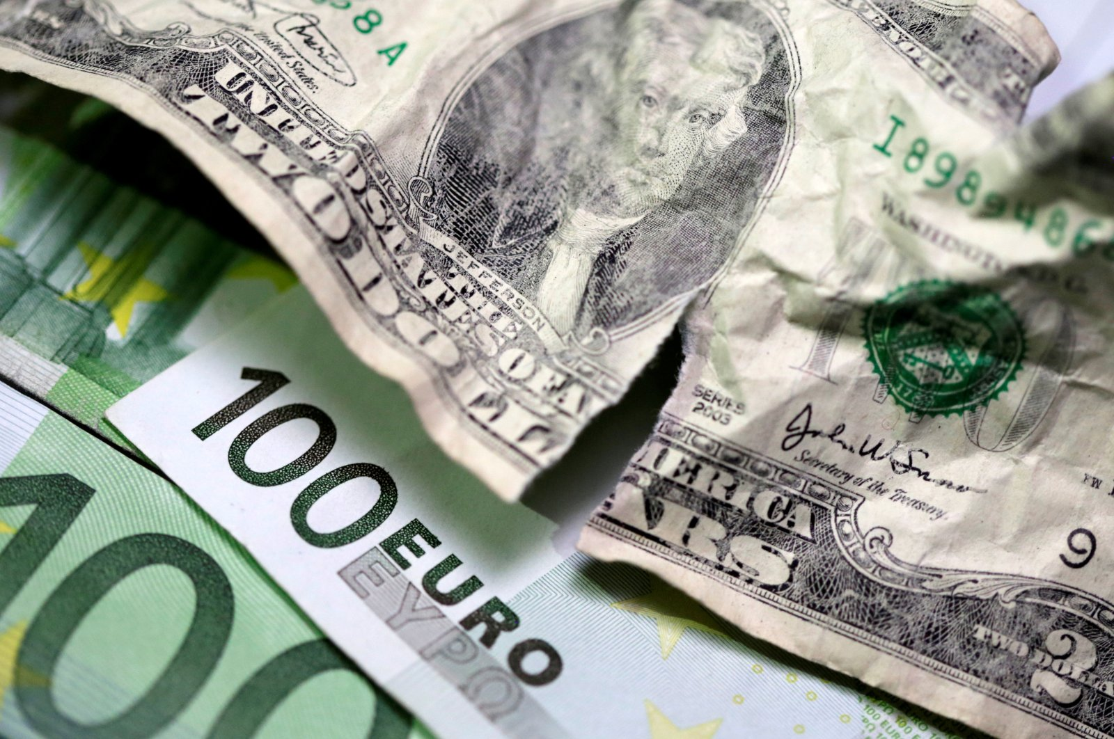 U.S. dollar and euro banknotes in this picture illustration taken May 3, 2018. (Reuters Photo)