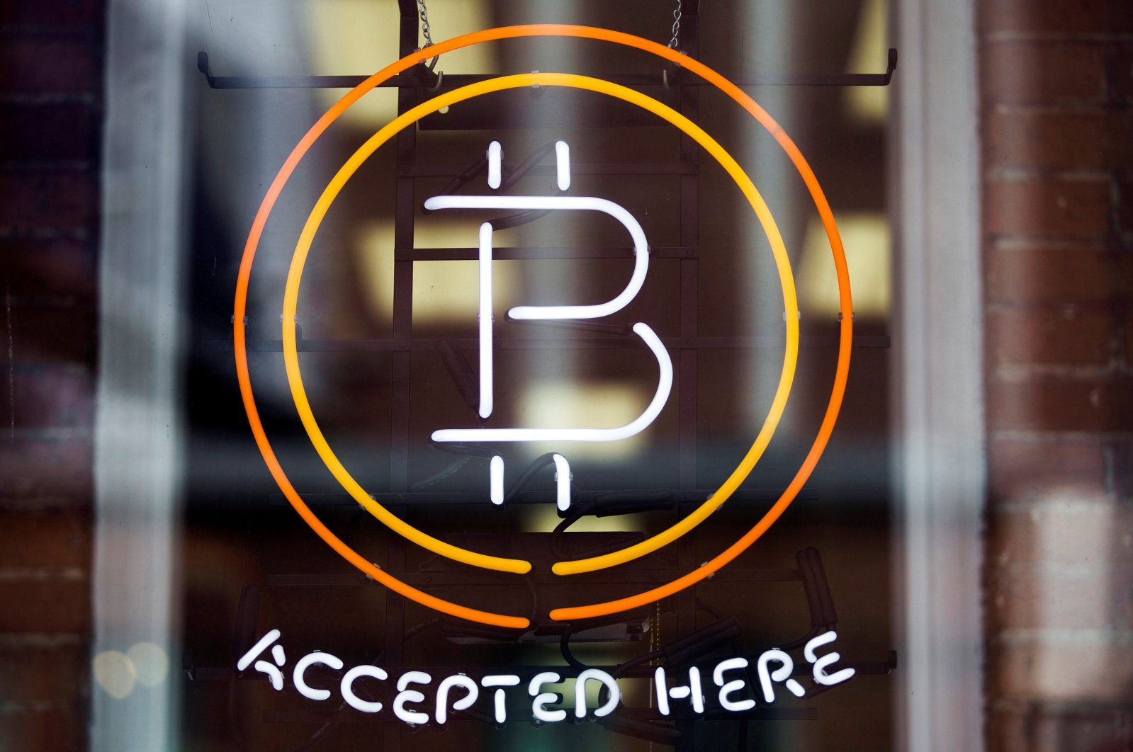 A Bitcoin sign in a window in Toronto, Canada, May 8, 2014. (Reuters File Photo)