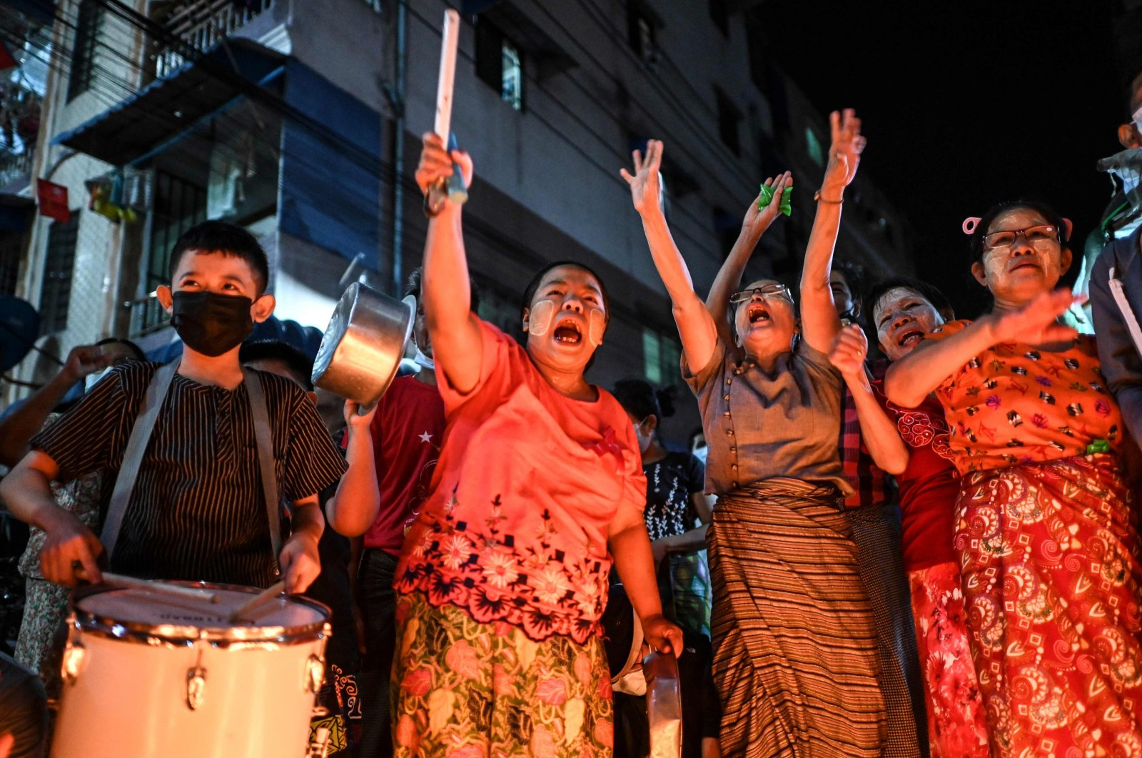 People take part in a noise campaign on the street after calls for protest against the military coup emerged on social media, in Yangon, Myanmar, Feb. 5, 2021. (AFP Photo)