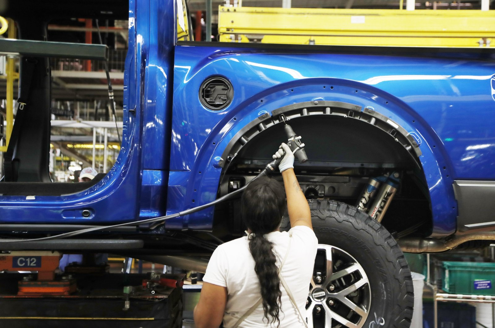 A United Auto Workers assemblyman works on a 2018 Ford F-150 truck being assembled at the Ford Rouge assembly plant in Dearborn, Michigan, Sept. 27, 2018. (AP Photo)