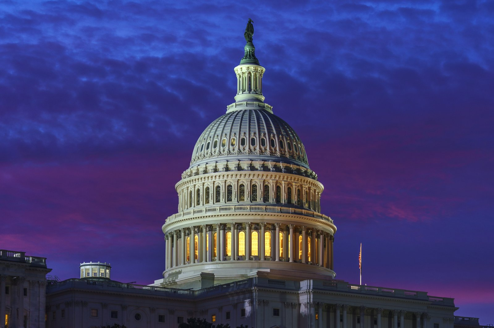 Red and blue shades of dawn fill the sky behind Capitol Hill in Washington, D.C., Nov. 6, 2020. (AP Photo)
