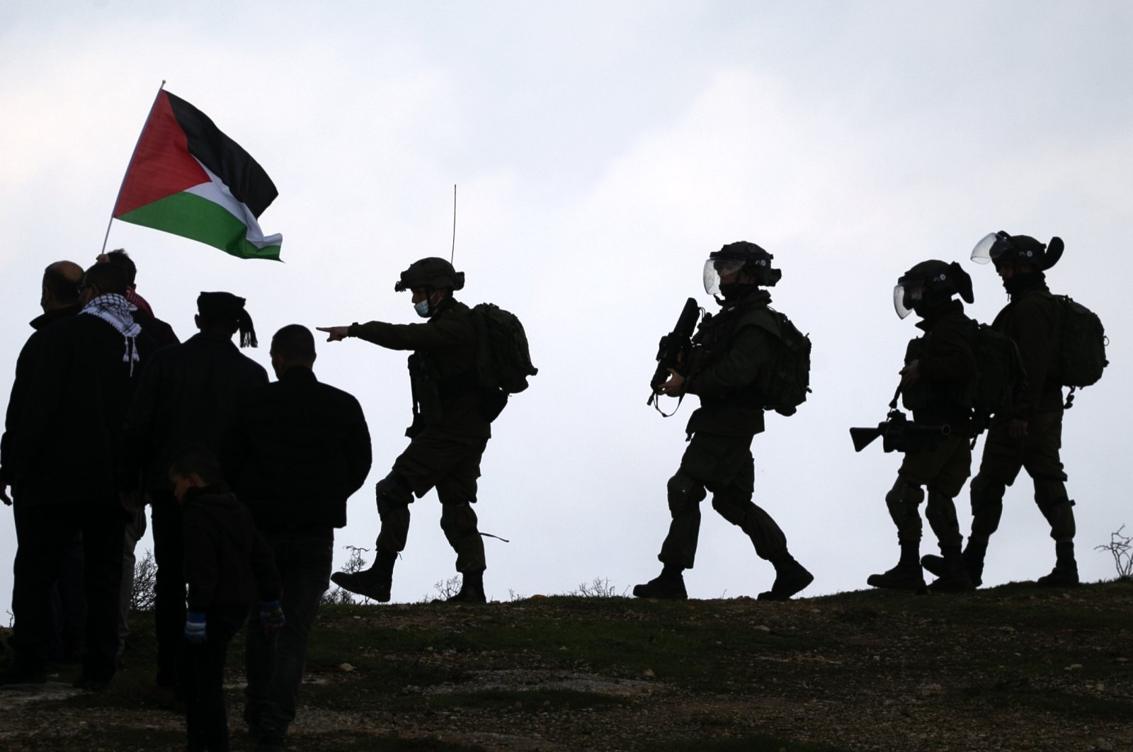 Palestinian protesters face Israeli security forces following a demonstration against the expansion of settlements near the village of Beit Dajan, east of Nablus, in the occupied West Bank, Feb. 5, 2021. (AFP Photo)