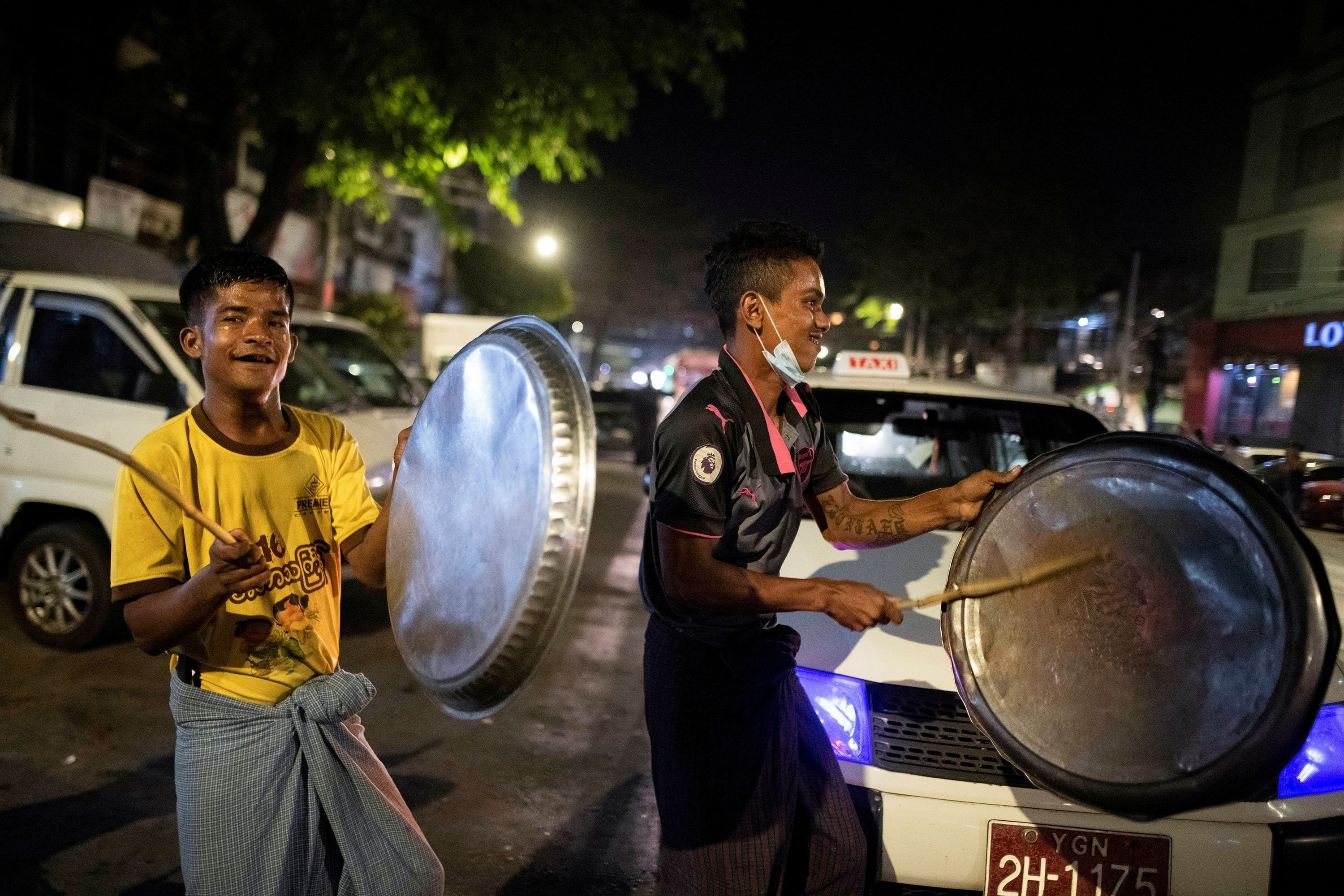 Men hit pots during a night protest against the military coup in Yangon, Myanmar on Feb. 4, 2021. (Reuters Photo)