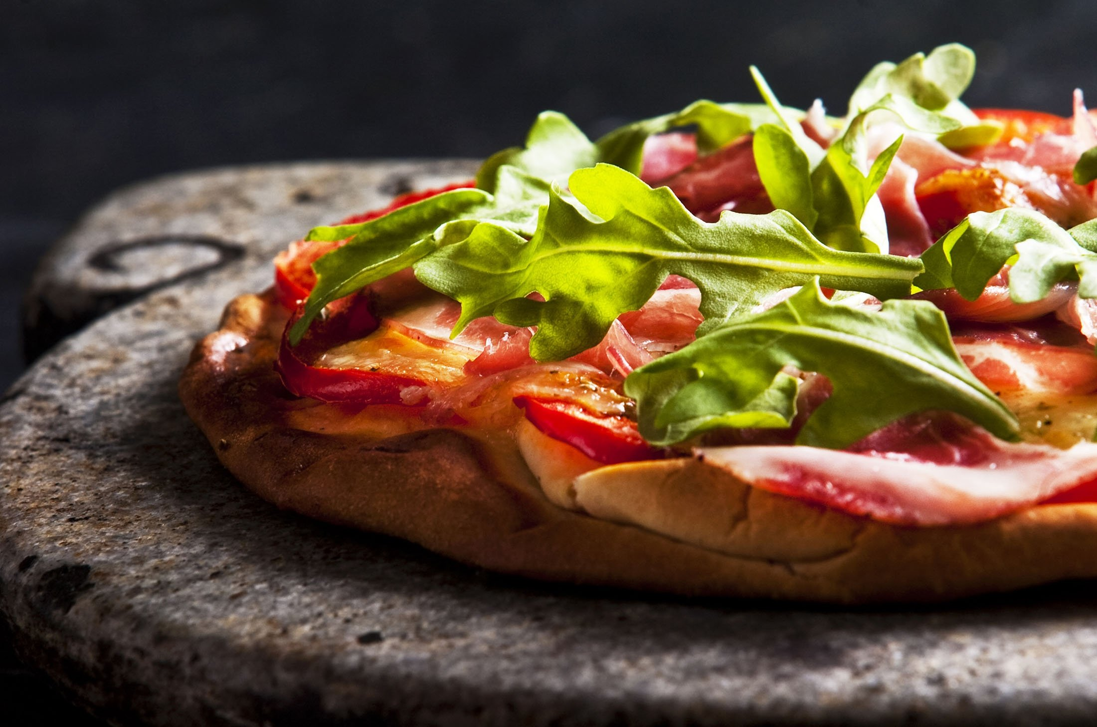 To replicate a wood-fired oven, try to use a pizza stone when baking your pizza. (Shutterstock Photo)