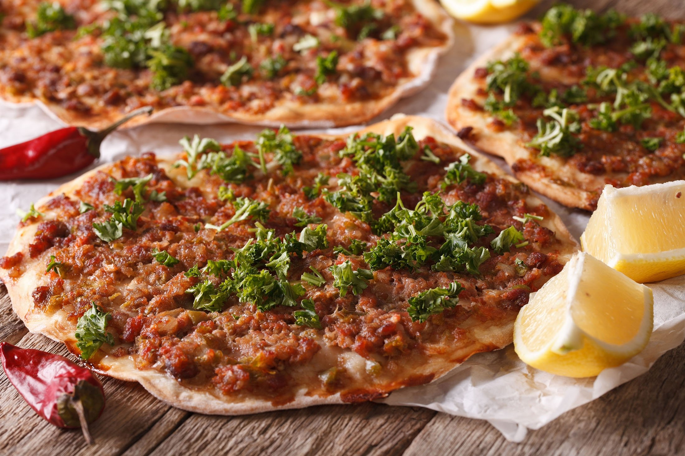 Lahmacun is similar to Turkish pide but much thinner. (Shutterstock Photo)