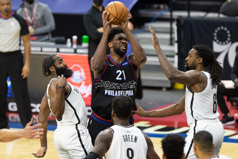 Philadelphia 76ers center Joel Embiid (C) shoots against Brooklyn Nets during an NBA match at Wells Fargo Center, Philadelphia, Pennsylvania, U.S., Feb 6, 2021. (REUTERS Photo)
