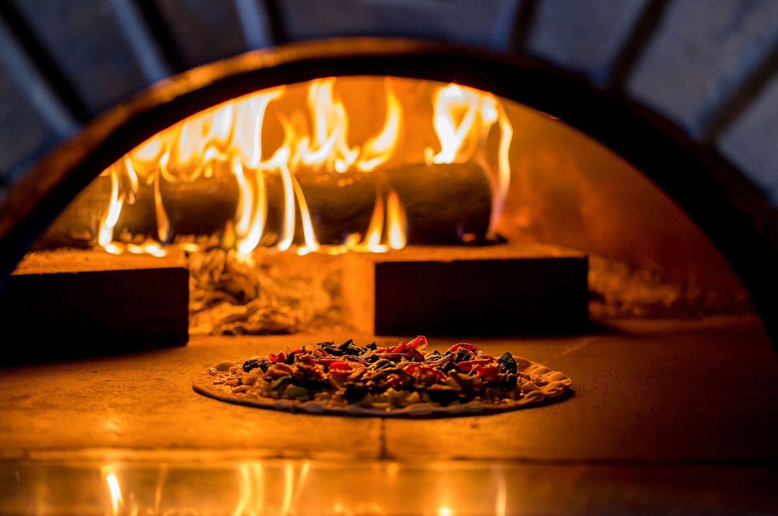 A wood-fired oven may feel like the secret to a crispy crust, but the key is not to use a rolling pin. (Shutterstock Photo)